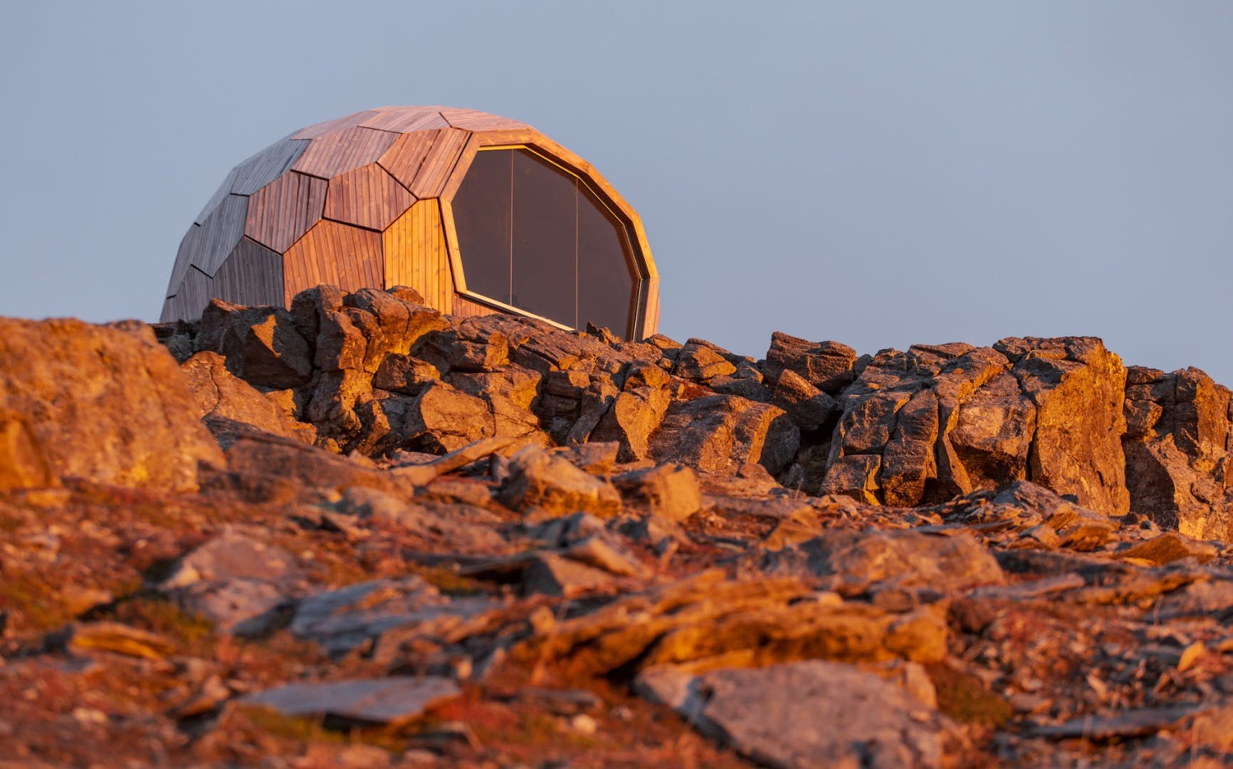 Prefab mountaintop cabin provides protection for hikers