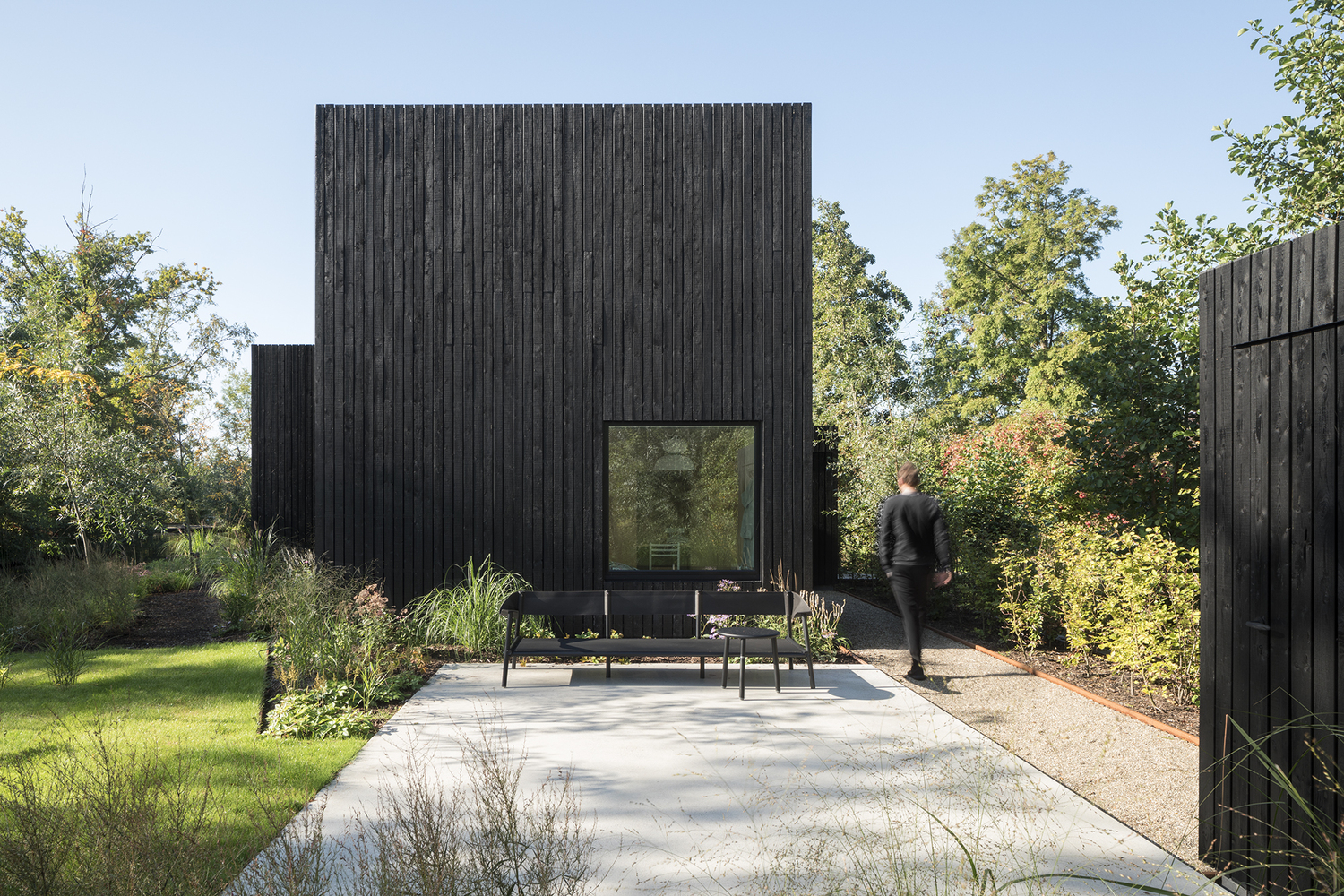 Black timber house is small but efficient