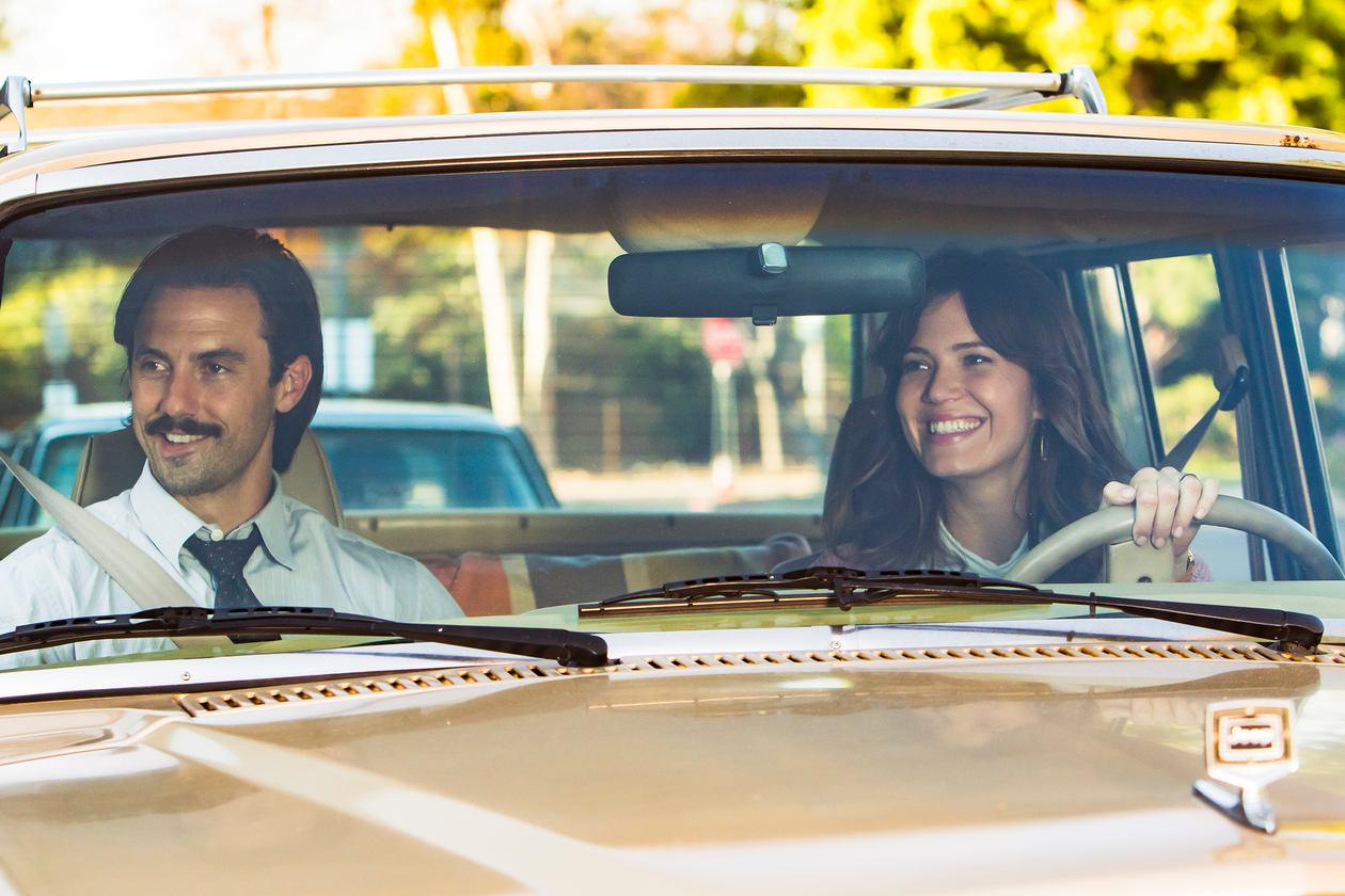 """Two actors from the NBC show """"This Is Us"""" driving a car."""