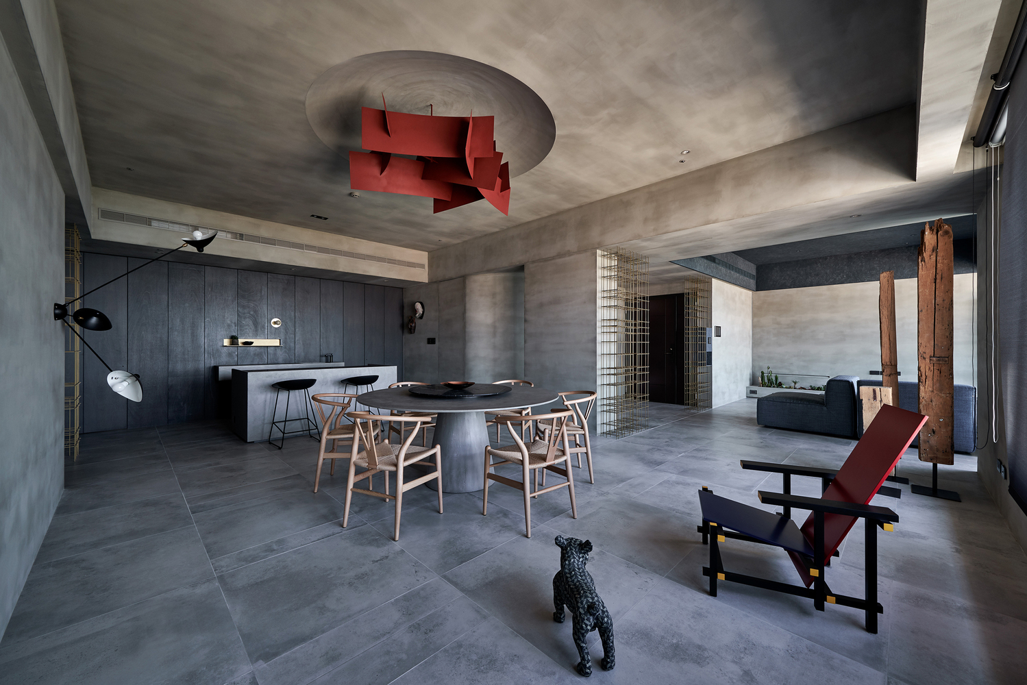Concrete dining room with red pendant