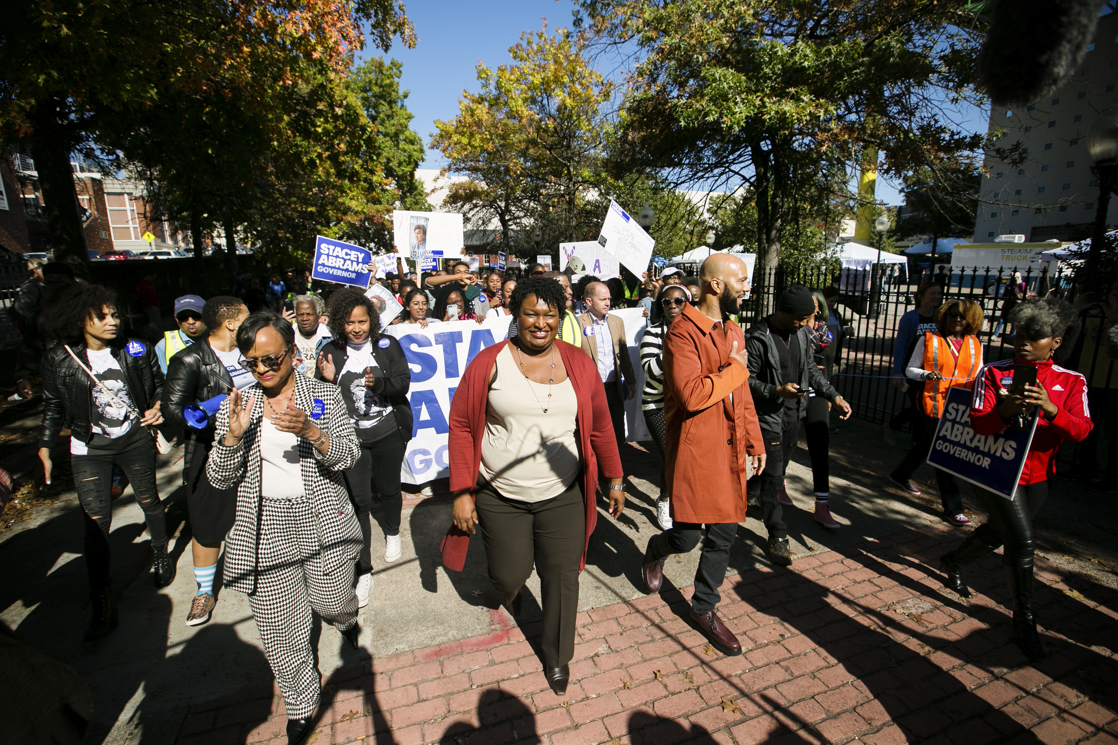 """Former Democratic Georgia gubernatorial candidate Stacey Abrams and Grammy-winning artist Common lead voters during a """"Souls to The Polls"""" march in Atlanta, Georgia, on October 28, 2018."""