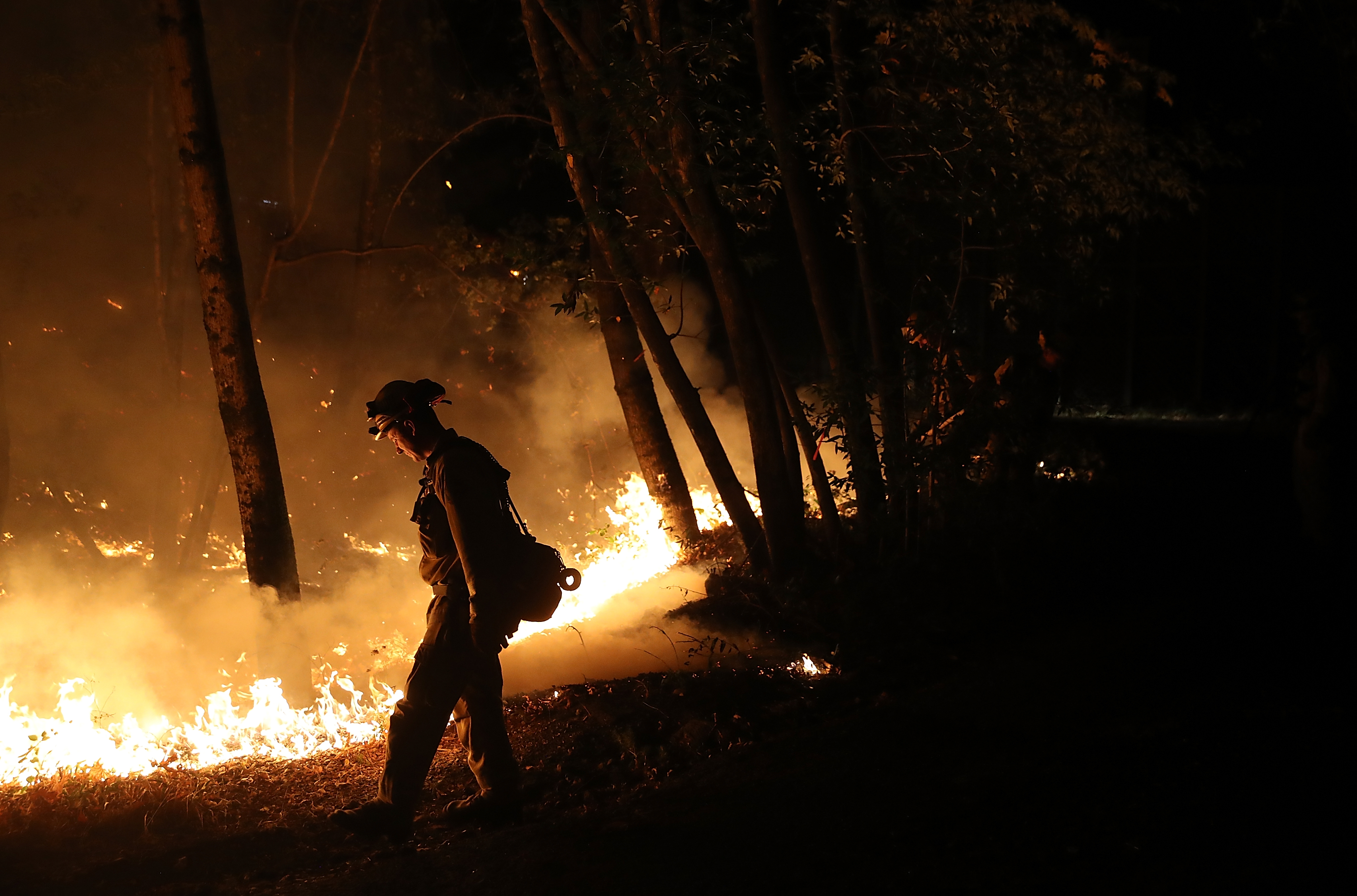 CalFire firefighter Brandon Tolp uses a drip torch during a firing operation while battling the Tubbs Fire.