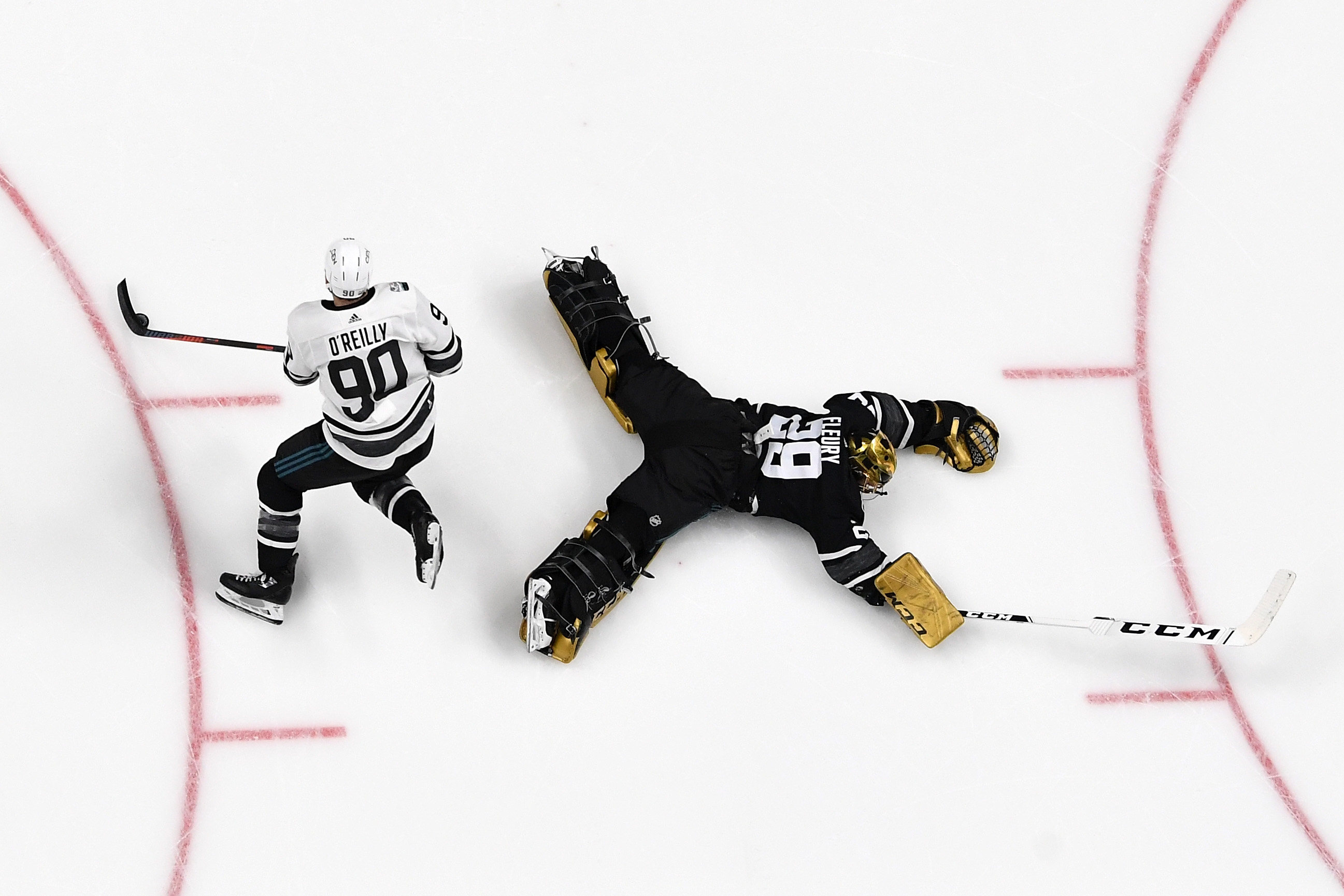 SAN JOSE, CA - JANUARY 26: Ryan O'Reilly #90 of the St. Louis Blues skates around Marc-Andre Fleury #29 of the Vegas Golden Knights for a goal during the 2019 Honda NHL All-Star Game at SAP Center on January 26, 2019 in San Jose, California.
