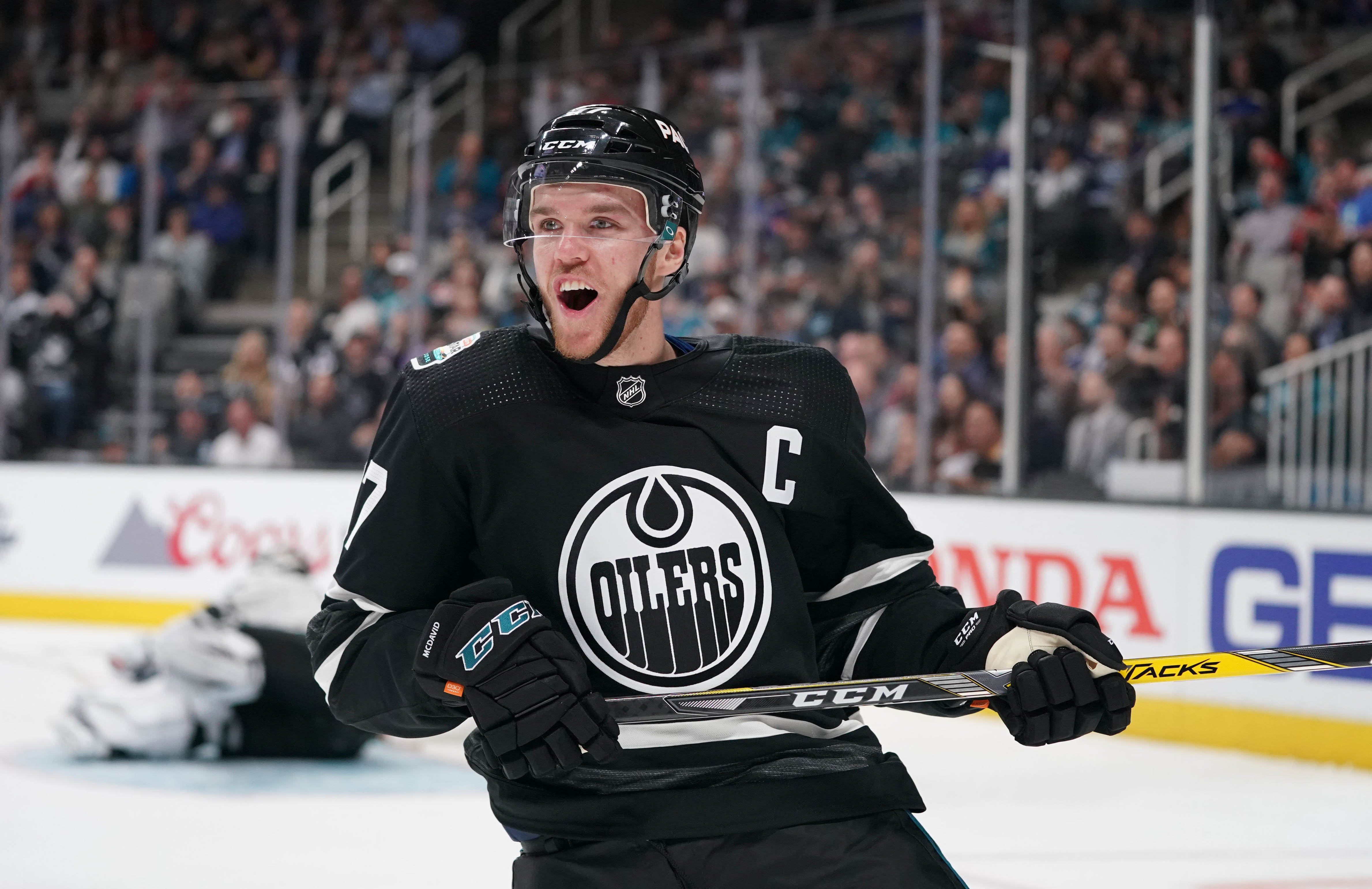 Jan 26, 2019; San Jose, CA, USA; Pacific Division player Connor McDavid (97) of the Edmonton Oilers celebrates after a goal against the Central division in the 2019 NHL All Star Game at SAP Center.