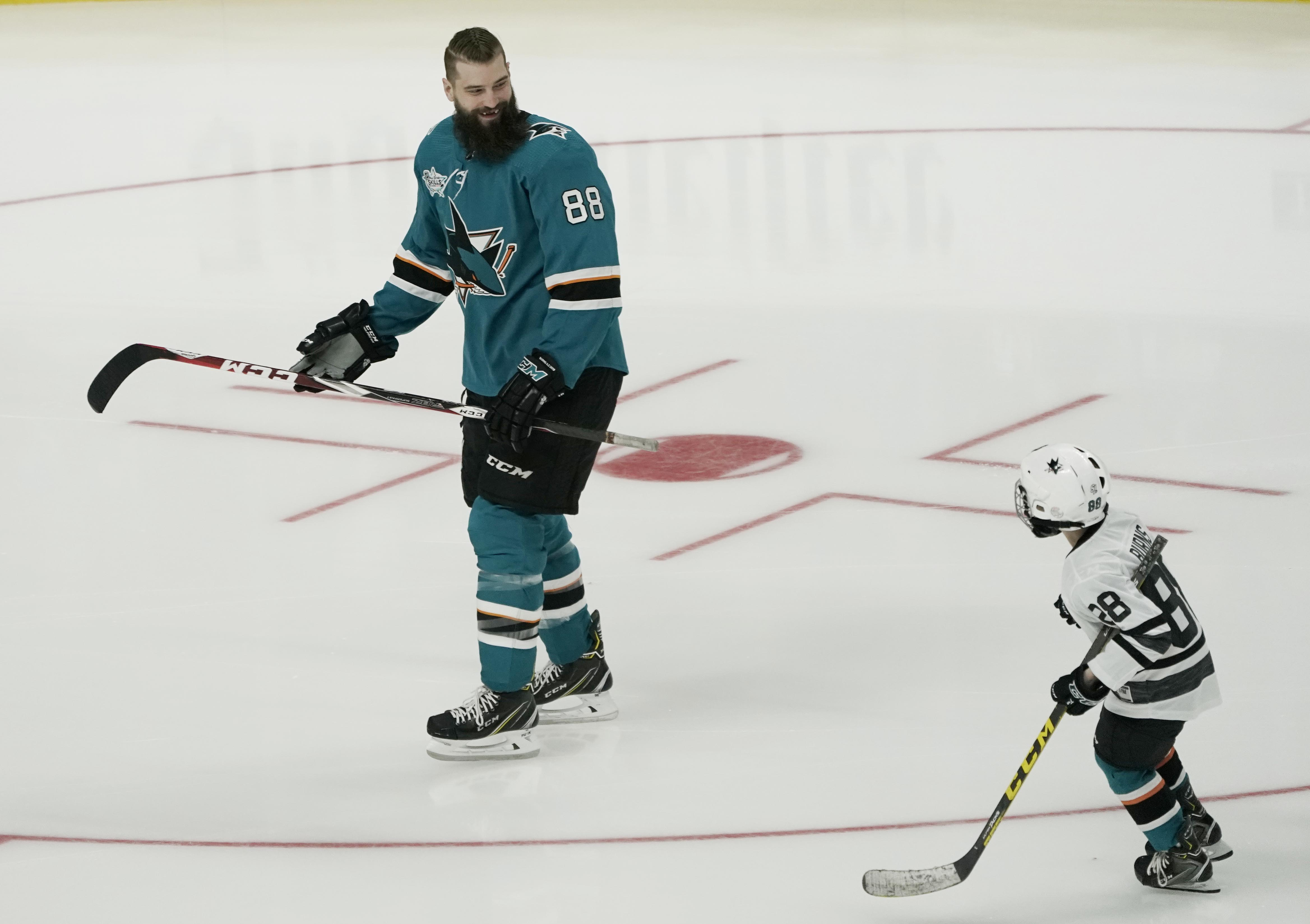 Jan 25, 2019; San Jose, CA, USA; Pacific Division player Brent Burns (88) of the San Jose Sharks warms up with his son before the 2019 NHL All Star Game skills competition at SAP Center. Mandatory Credit: Stan Szeto