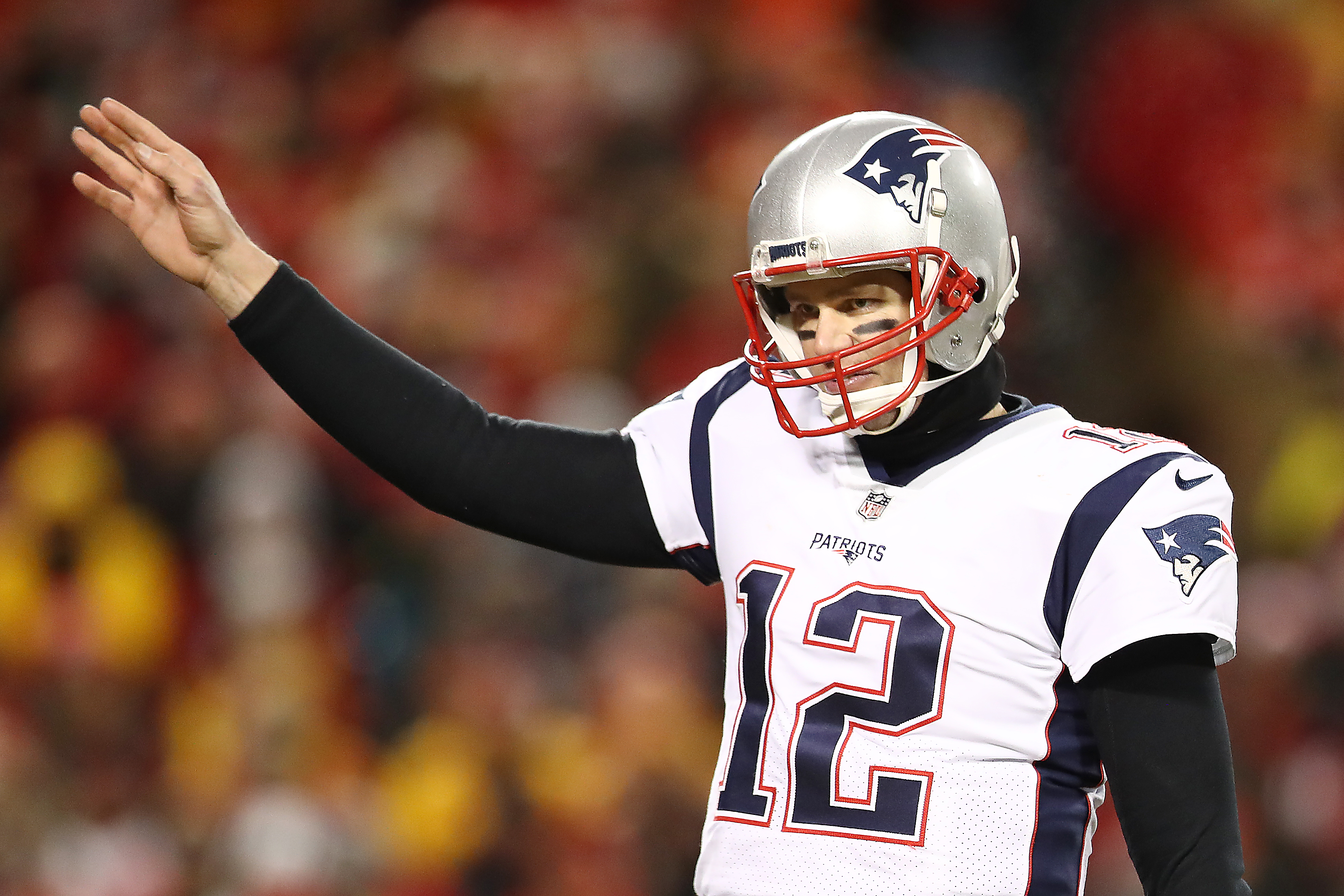 Tom Brady, number 12 of the New England Patriots, gestures downfield in the AFC Championship football game against the Kansas City Chiefs.