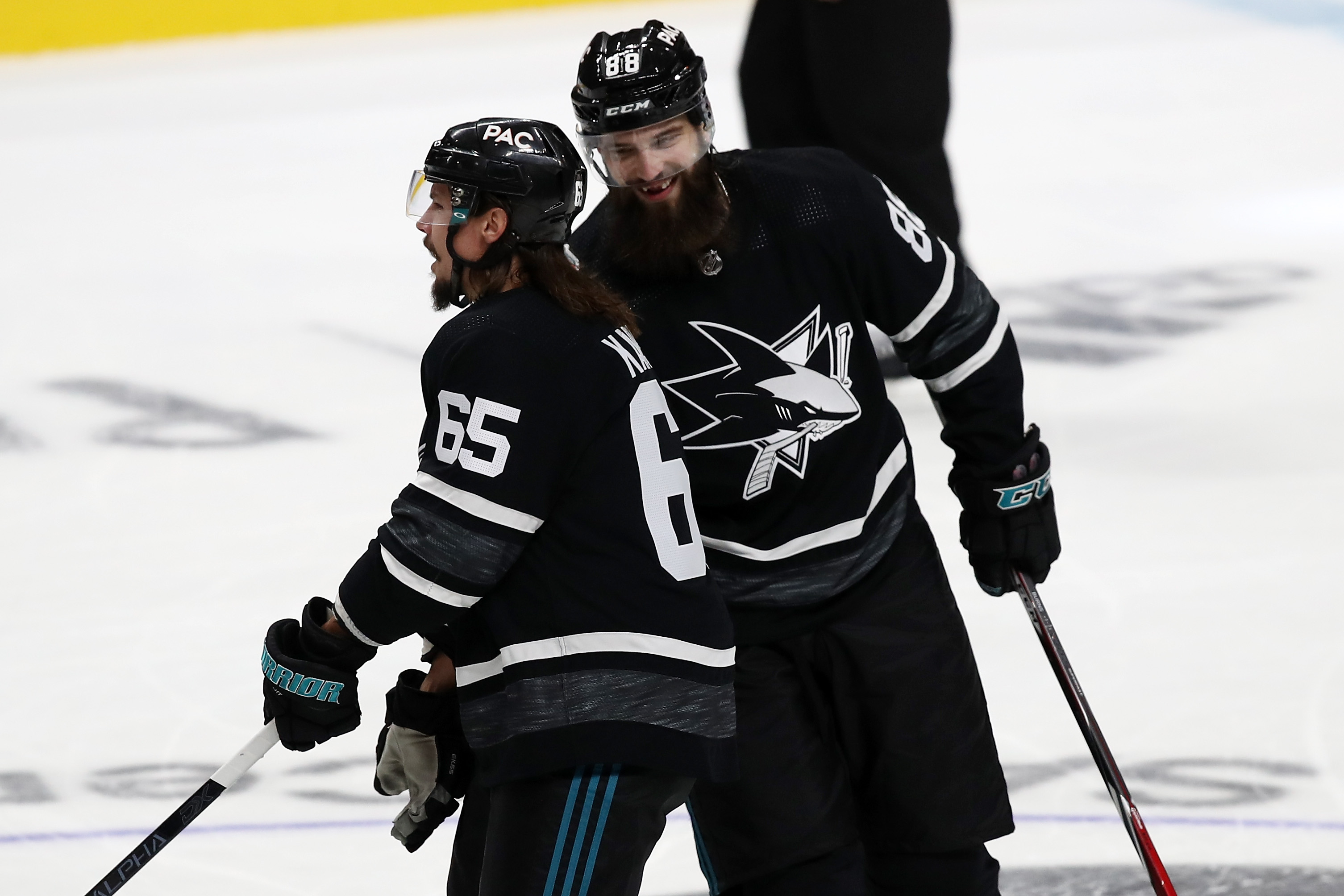 SAN JOSE, CA - JANUARY 26: Erik Karlsson #65 and Brent Burns #88 of the San Jose Sharks react to a goal during the 2019 Honda NHL All-Star Game at SAP Center on January 26, 2019 in San Jose, California.