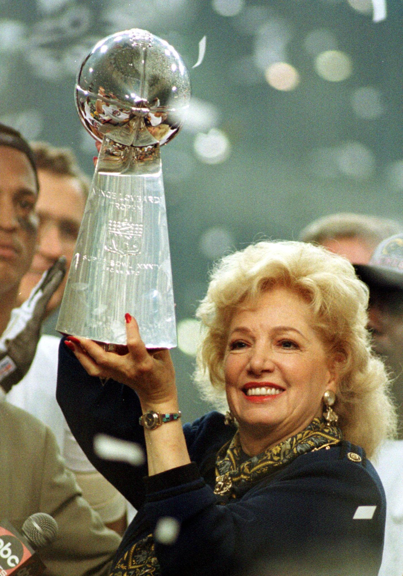 Owner Georgia Frontiere Of The St Louis Rams Lifts The Vince Lombardi Trophy After Supe...