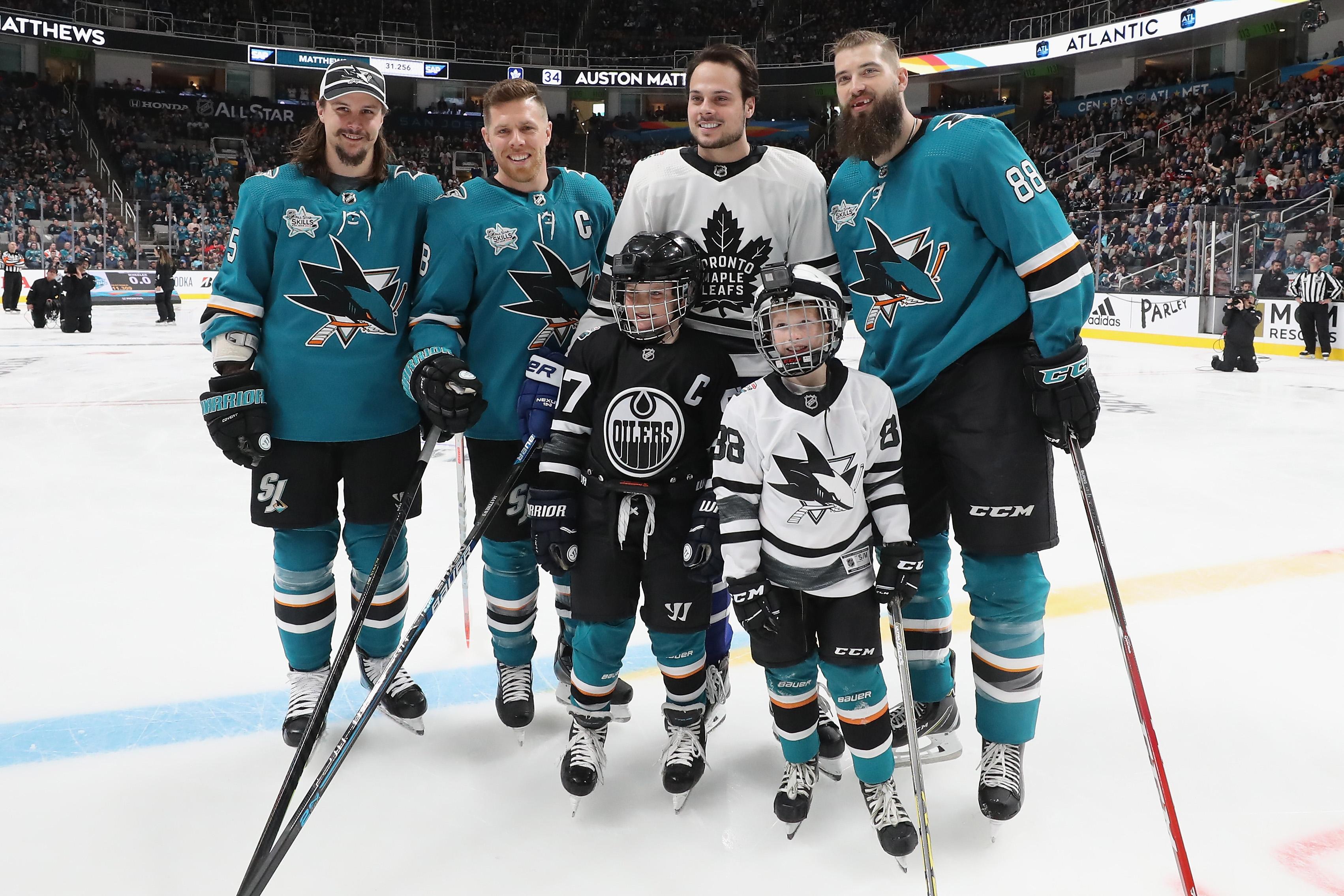 SAN JOSE, CA - JANUARY 25: Erik Karlsson #65, Joe Pavelski #8, and Brent Burns #88 of the San Jose Sharks pose with Auston Matthews #34 of the Toronto Maple Leafs during the Honda NHL Accuracy Shooting during the 2019 SAP NHL All-Star Skills at SAP Center