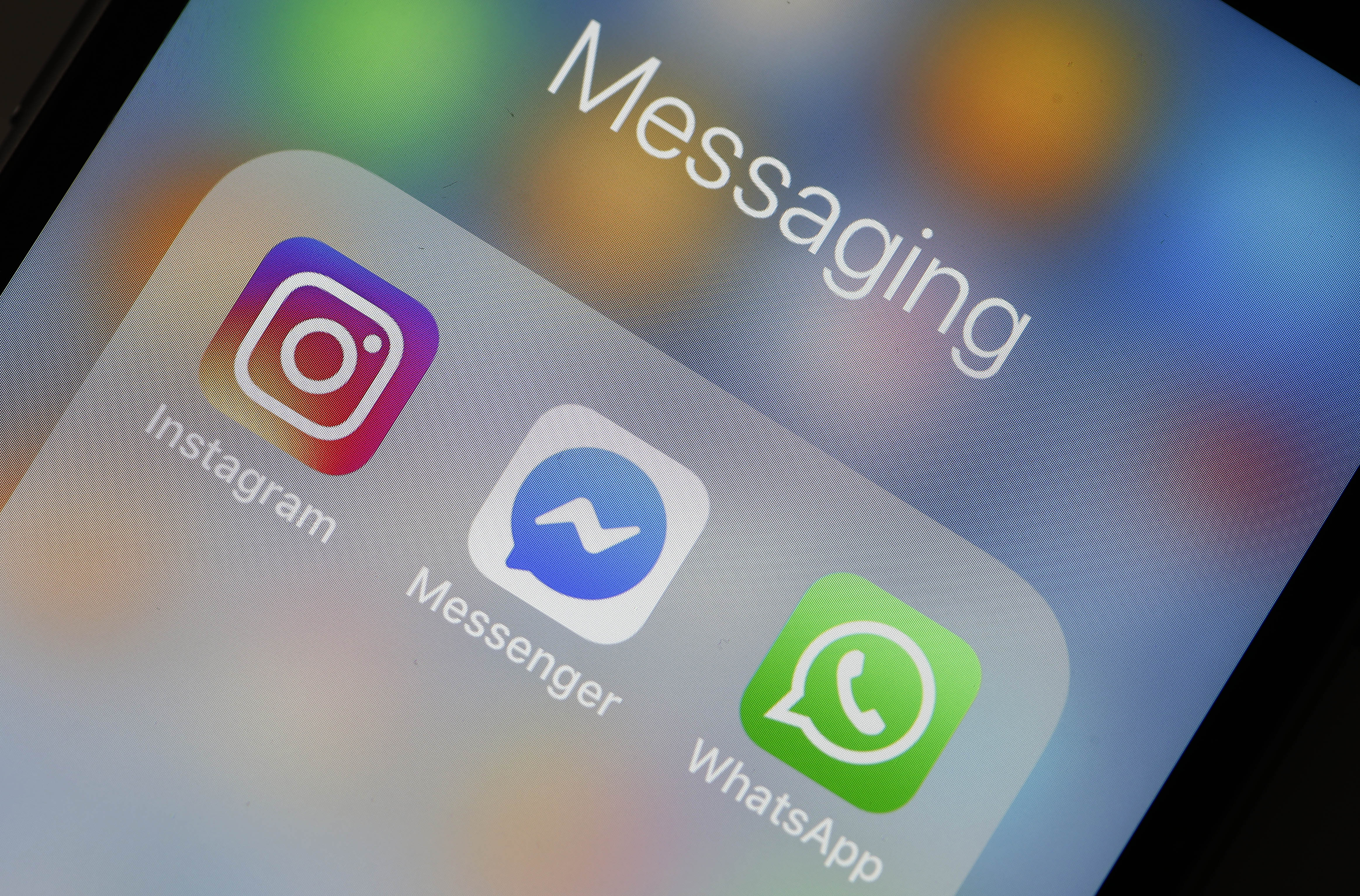 """WhatsApp, Instagram, and Facebook Messenger app icons on a mobile phone screen under the header """"Messaging."""""""