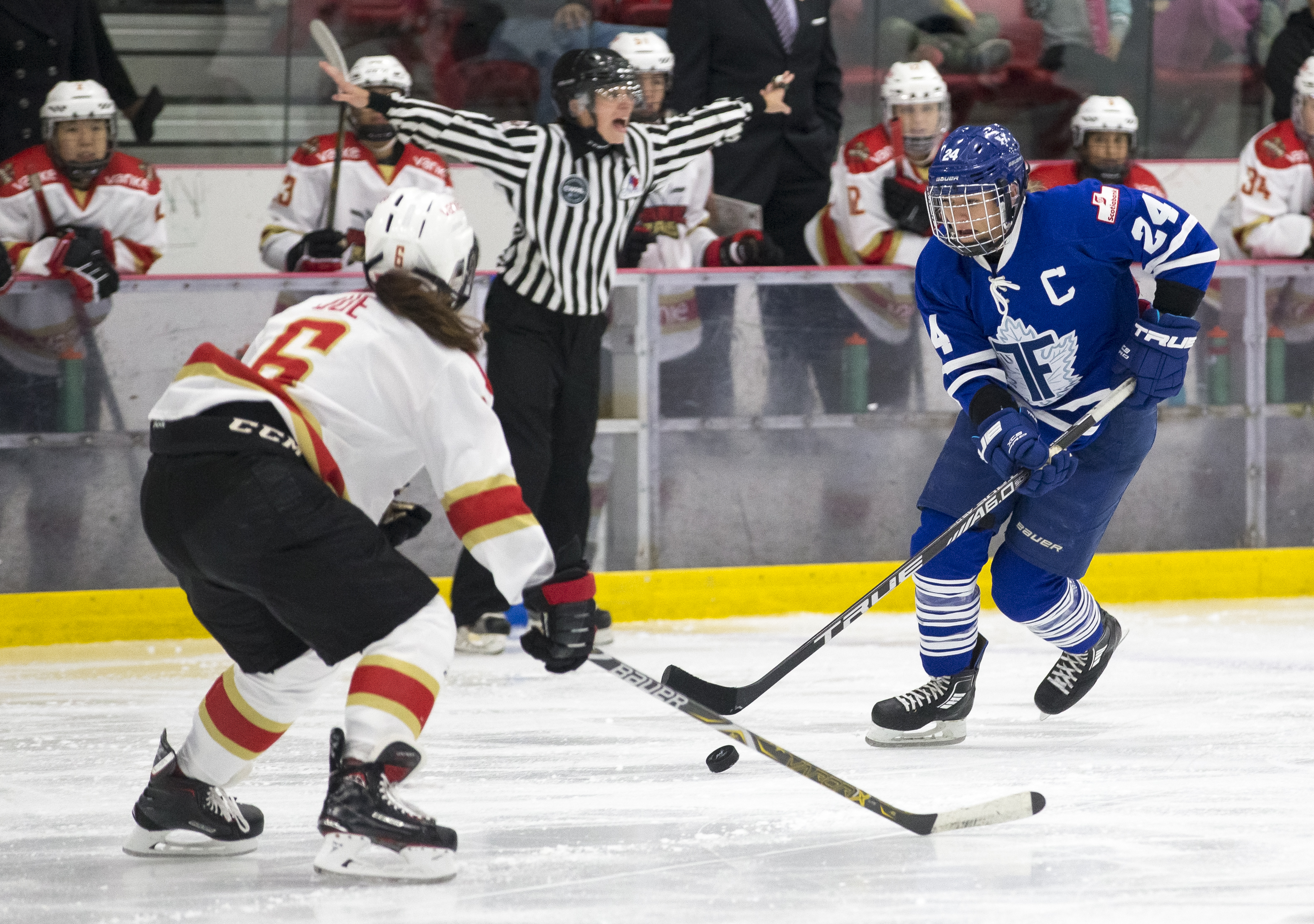 Natalie Spooner of the Toronto Furies (24) takes on Melanie Jue (6) of the Shenzhen KRS Vanke Rays.