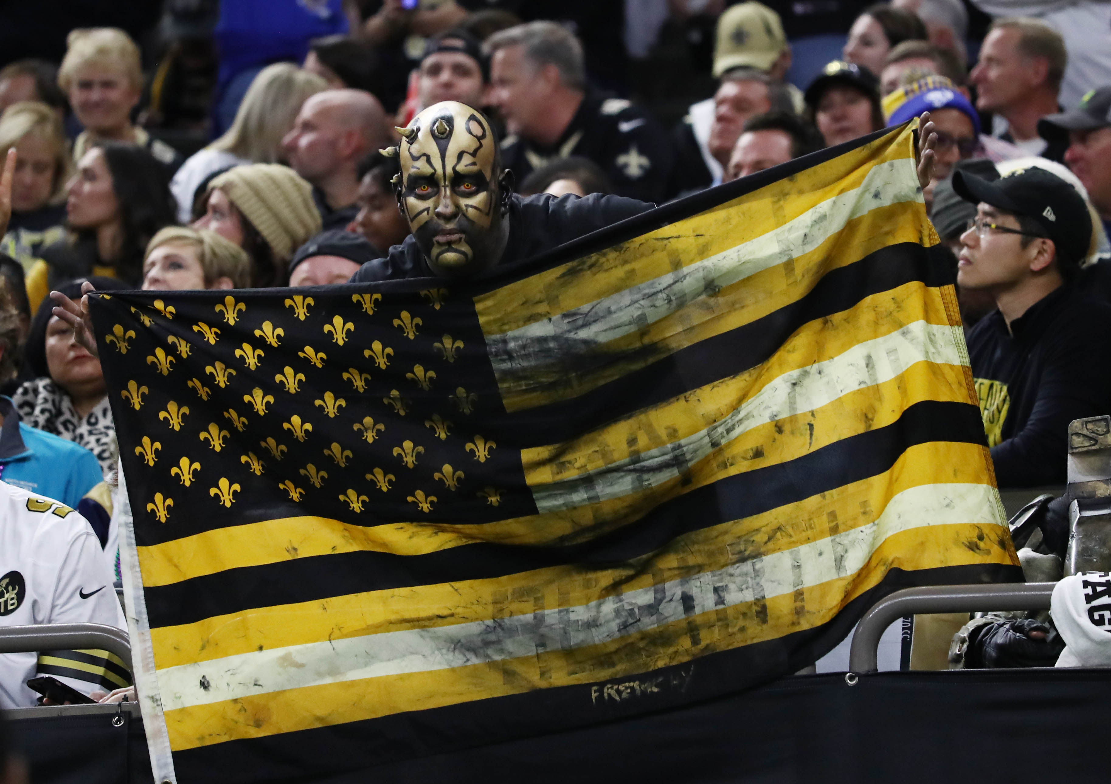 New Orleans Saints fan cheers against the Los Angeles Rams during the second quarter in the NFC Championship game