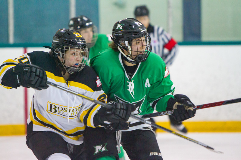 Markham Thunder's Jamie Lee Rattray jostles with Boston Blades Meaghan Spurling during a Markham home game in the 2017-18 season