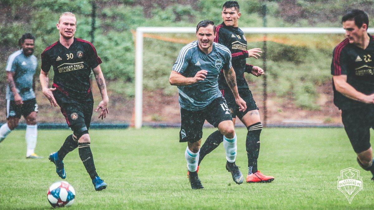 Jordan Morris chases the ball through heavy rain during a preseason loss to Atlanta.