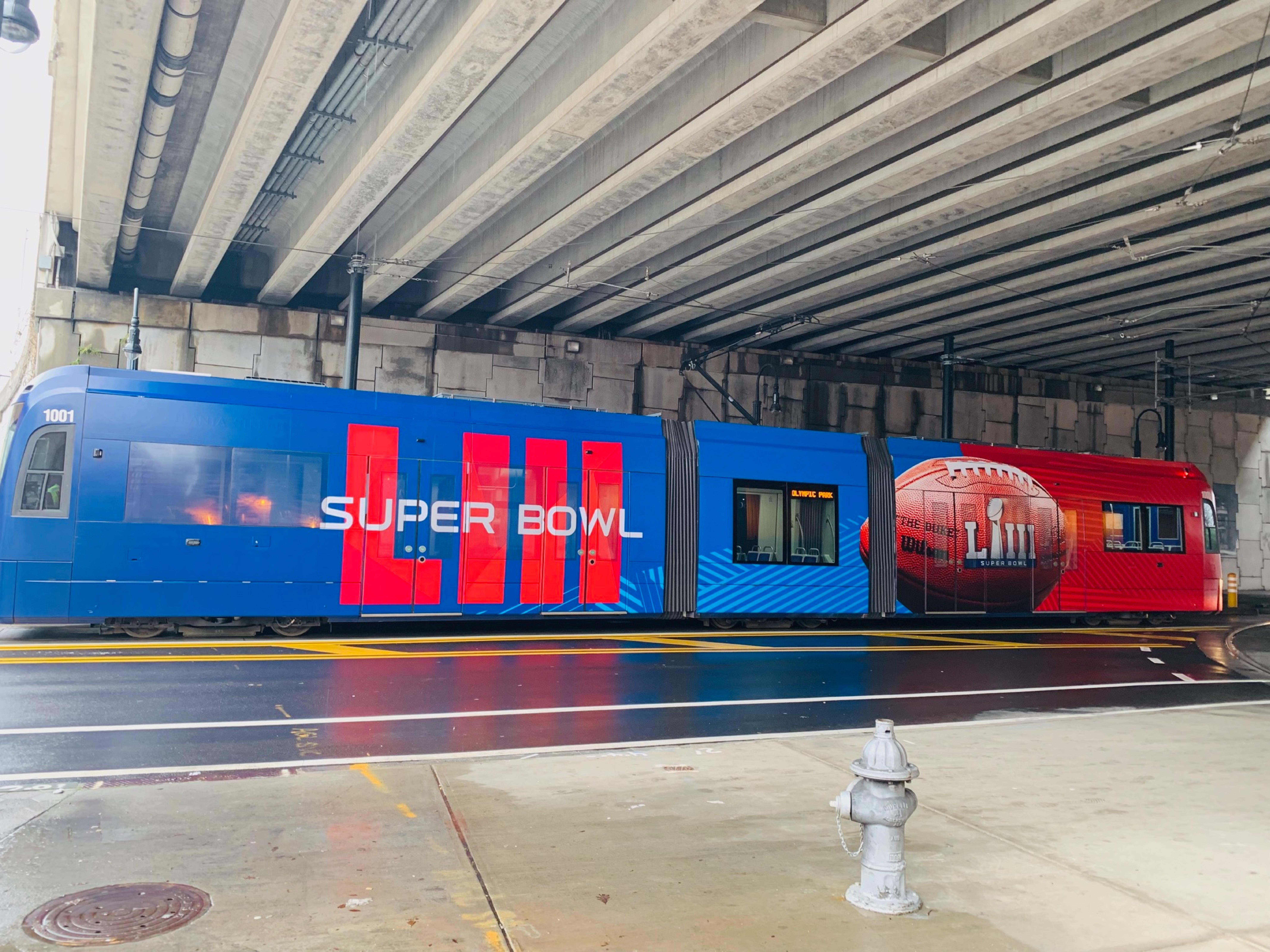A picture of the streetcar covered in a Super Bowl wrap