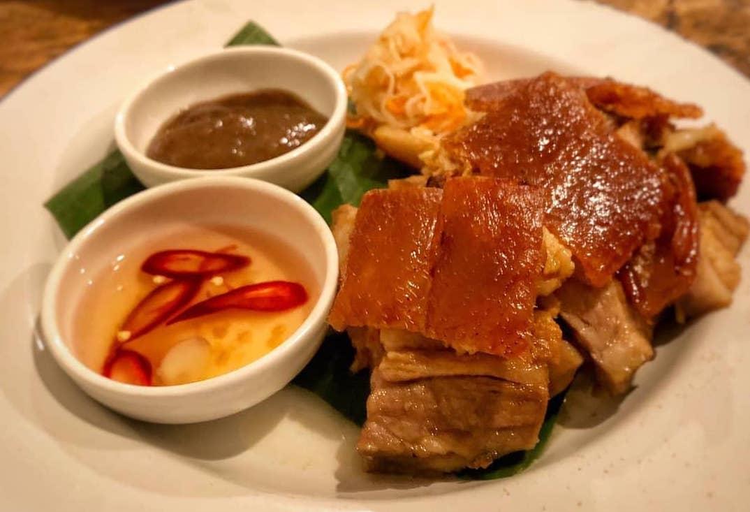 Lechon and mang tomas at Sarap Filipino Barbecue and Lechon at the Sun and 13 Cantons pub in Soho