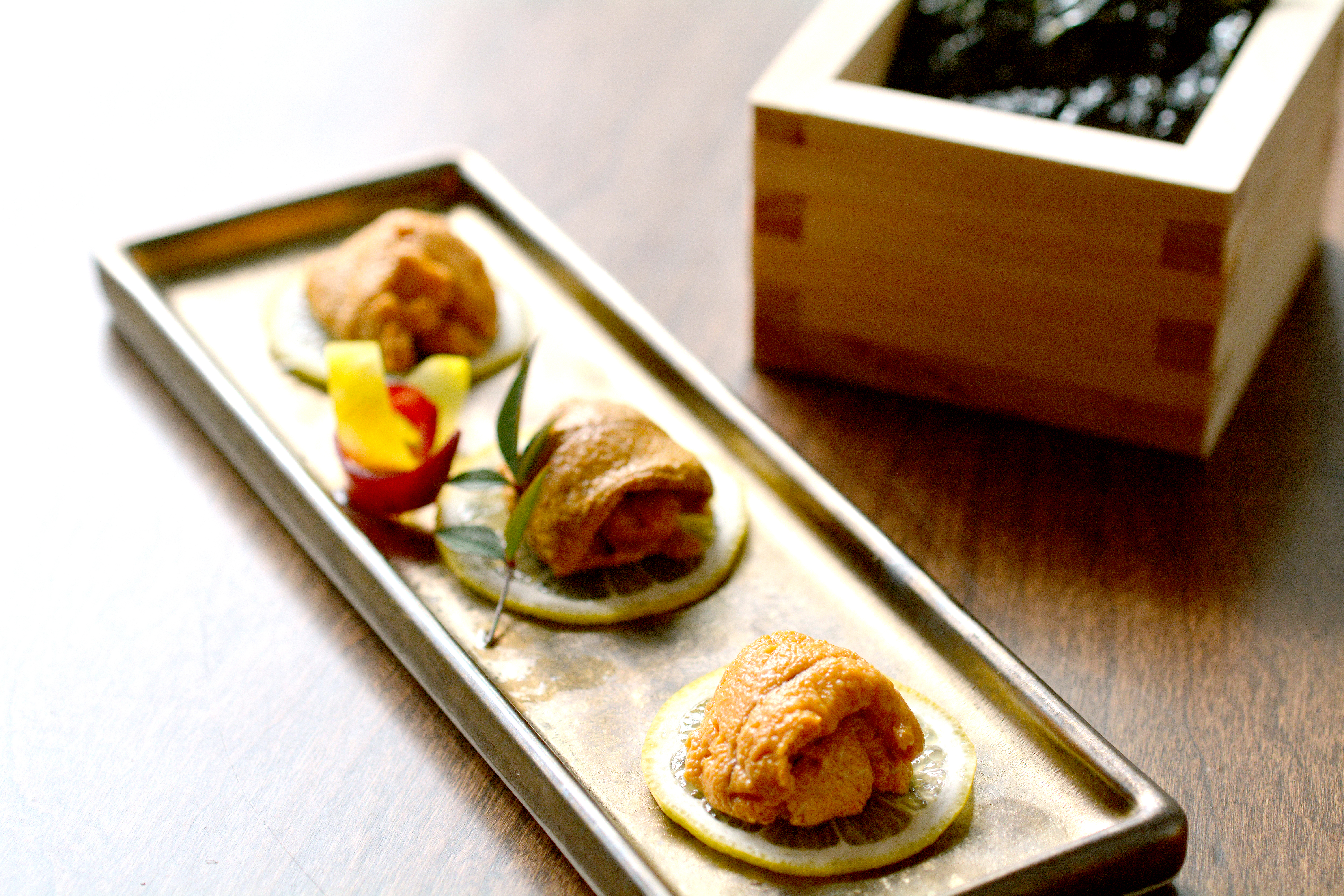 Japanese, California, and Maine uni with green tea seaweed at District M Sushi