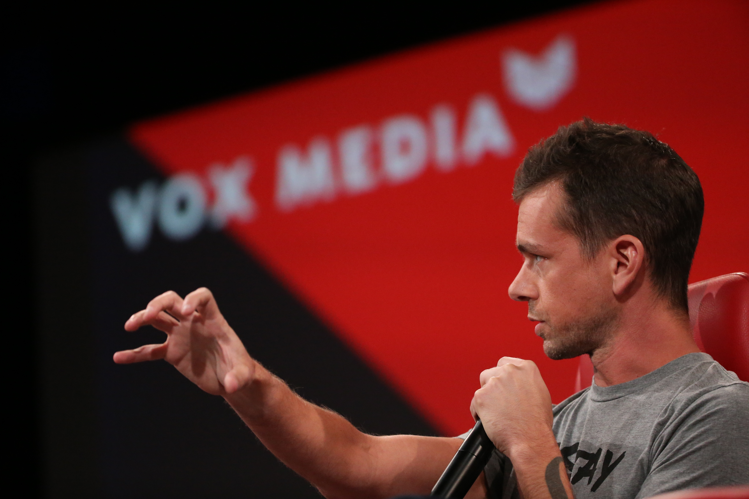 Twitter CEO Jack Dorsey onstage at Code in front of a backdrop that reads Vox Media.