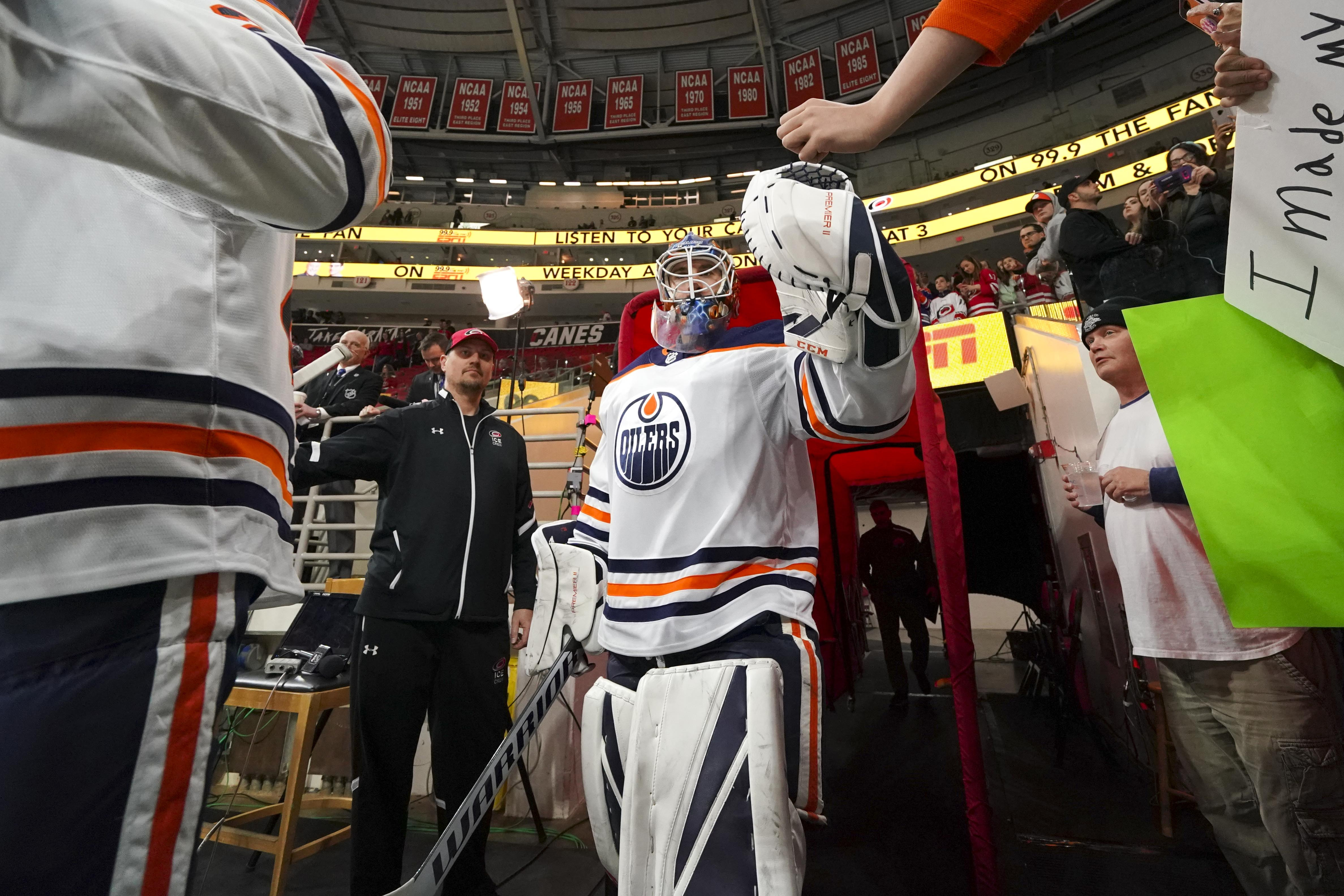 Feb 15, 2019; Raleigh, NC, USA; Edmonton Oilers goaltender Cam Talbot (33) walks past fans before a game against the Carolina Hurricanes at PNC Arena. The Hurricanes defeated the Oilers 3-1.