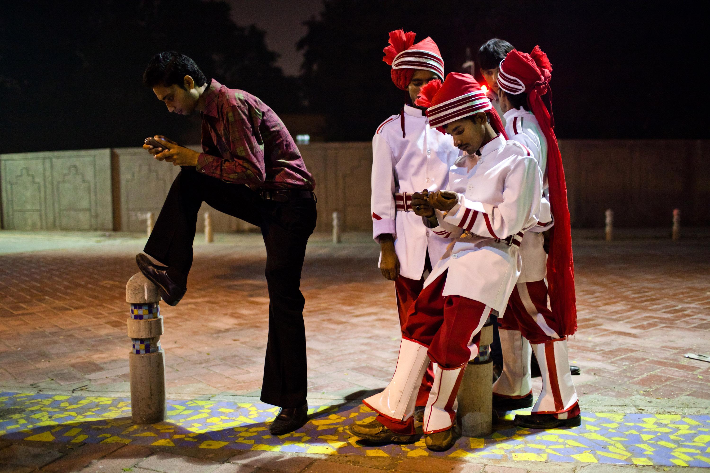 Members of the Rajan band Kotla Mubarakpur checking their cellphones.
