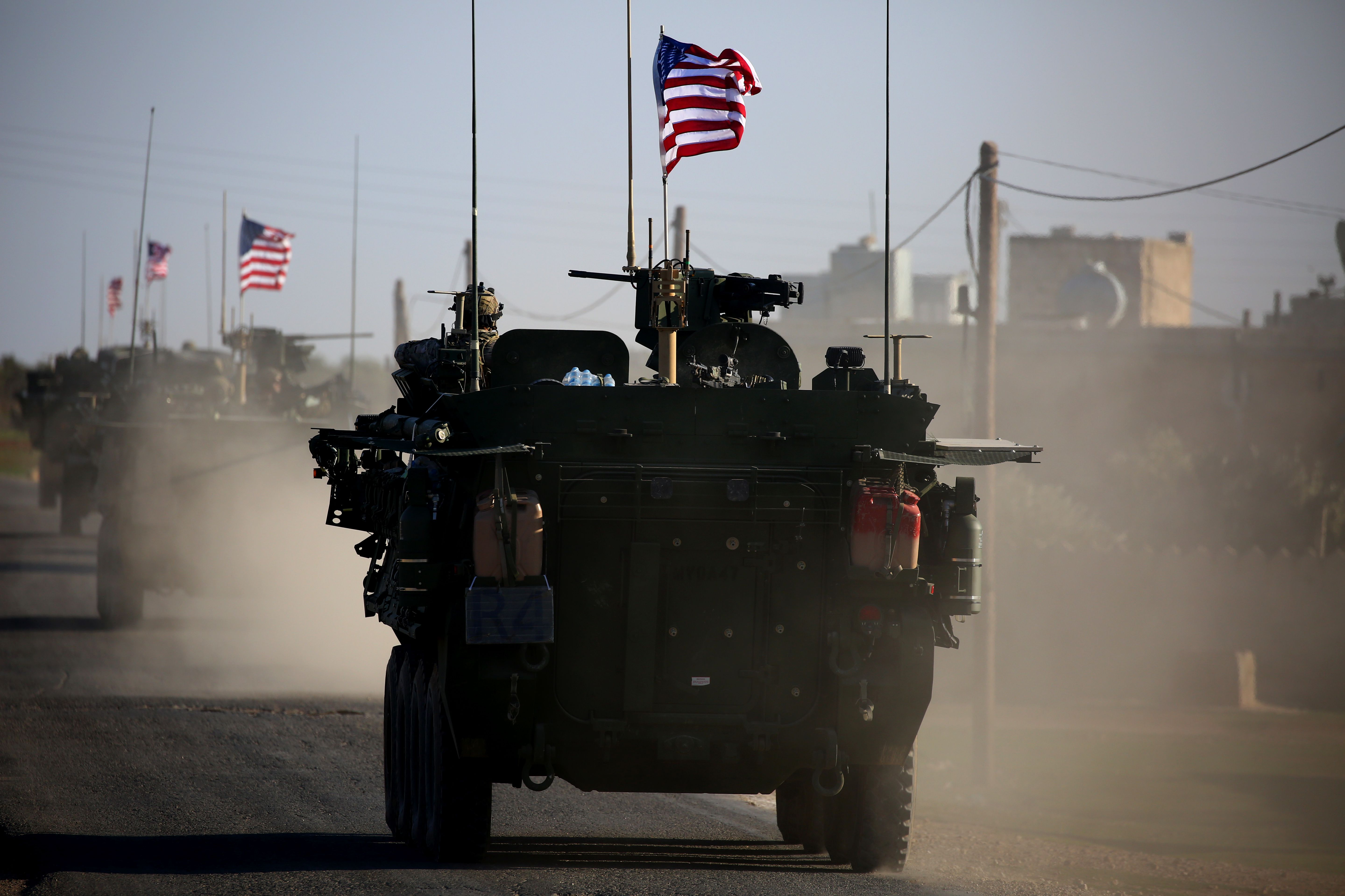 A convoy of US forces armored vehicles drives near the village of Yalanli, on the western outskirts of the northern Syrian city of Manbij, on March 5, 2017.
