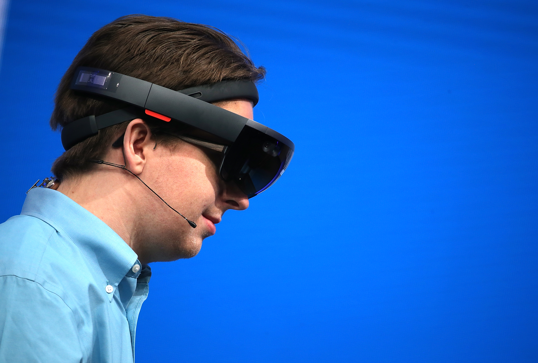 A man wearing a Microsoft HoloLens augmented reality headset.