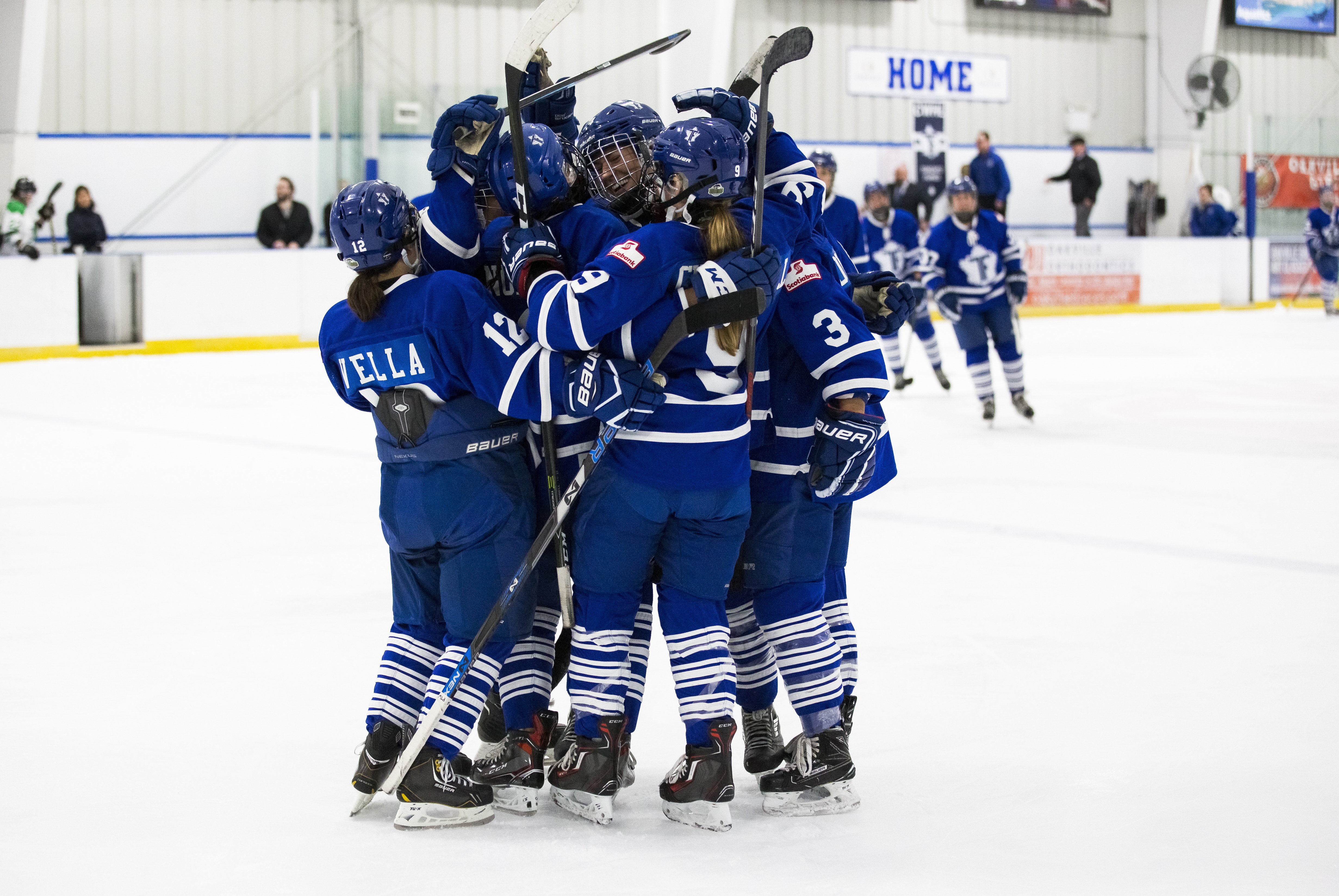 A group of Toronto Furies players hug in celebration of a win.