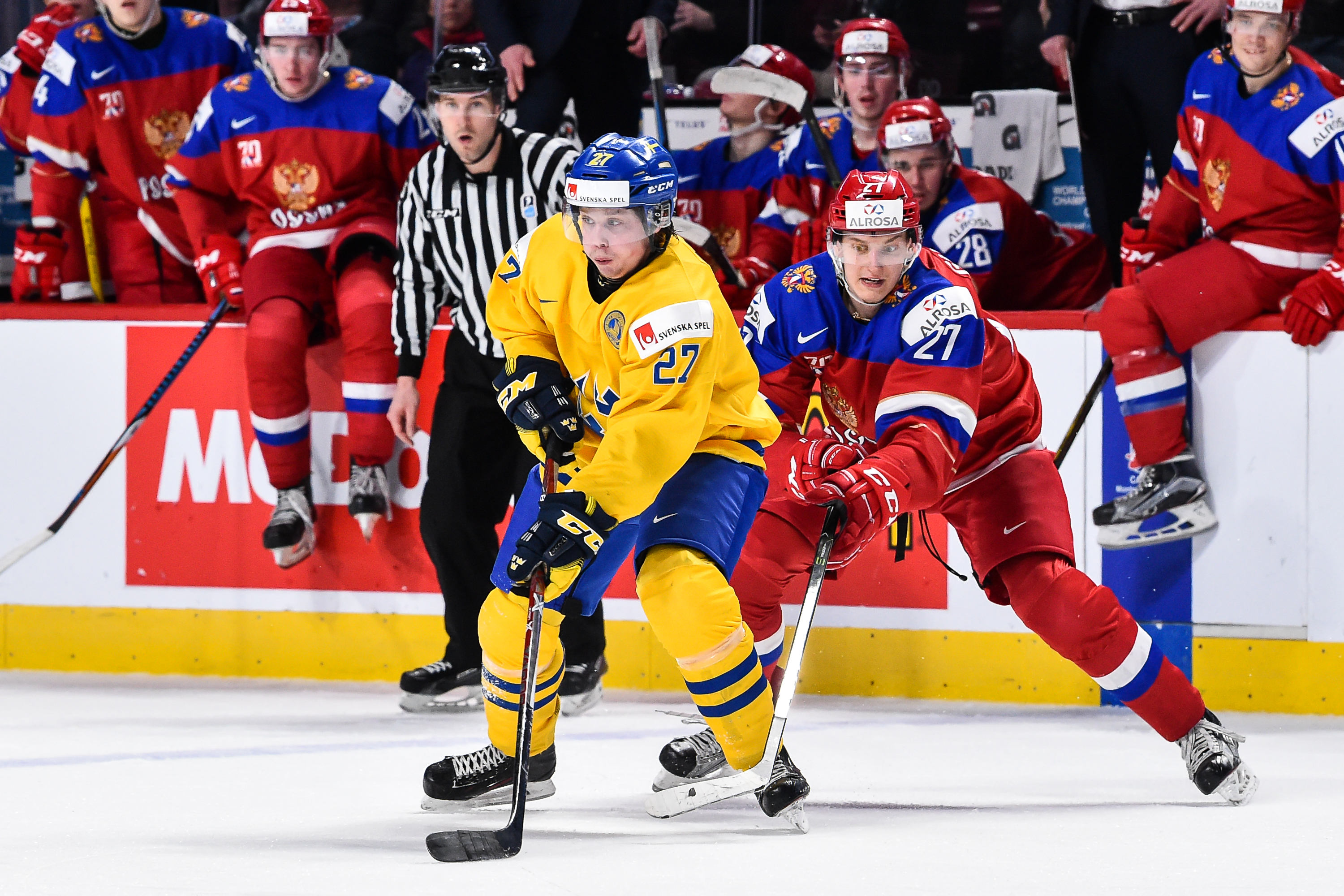 MONTREAL, QC - JANUARY 05: Jonathan Dahlen #27 of Team Sweden skates against Denis Guryanov #27 of Team Russia during the 2017 IIHF World Junior Championship bronze medal game at the Bell Centre on January 5, 2017 in Montreal, Quebec, Canada. Team Russia