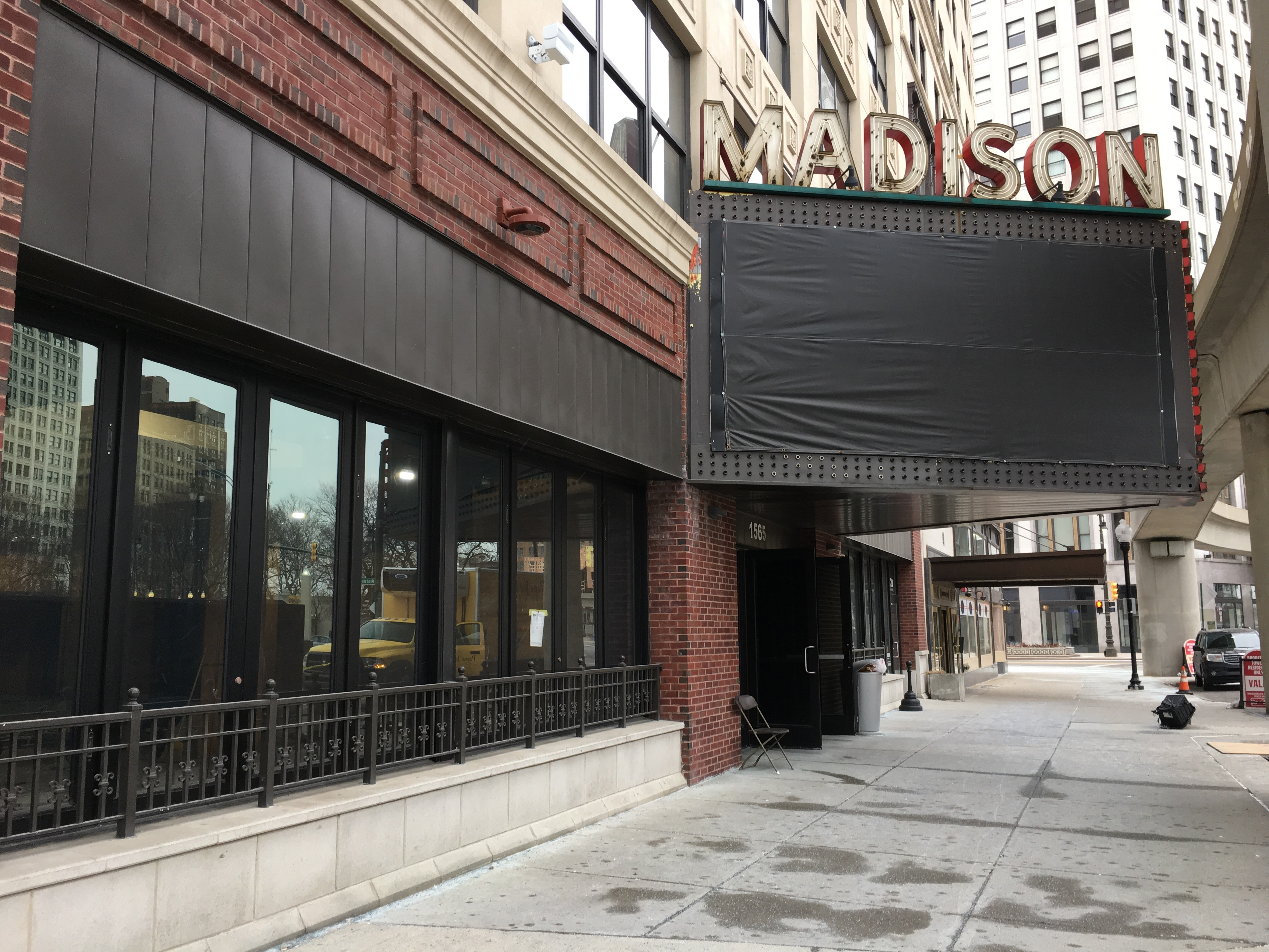 A photo of the Madison Building sign and Buddy's restaurant front with blacked out windows.