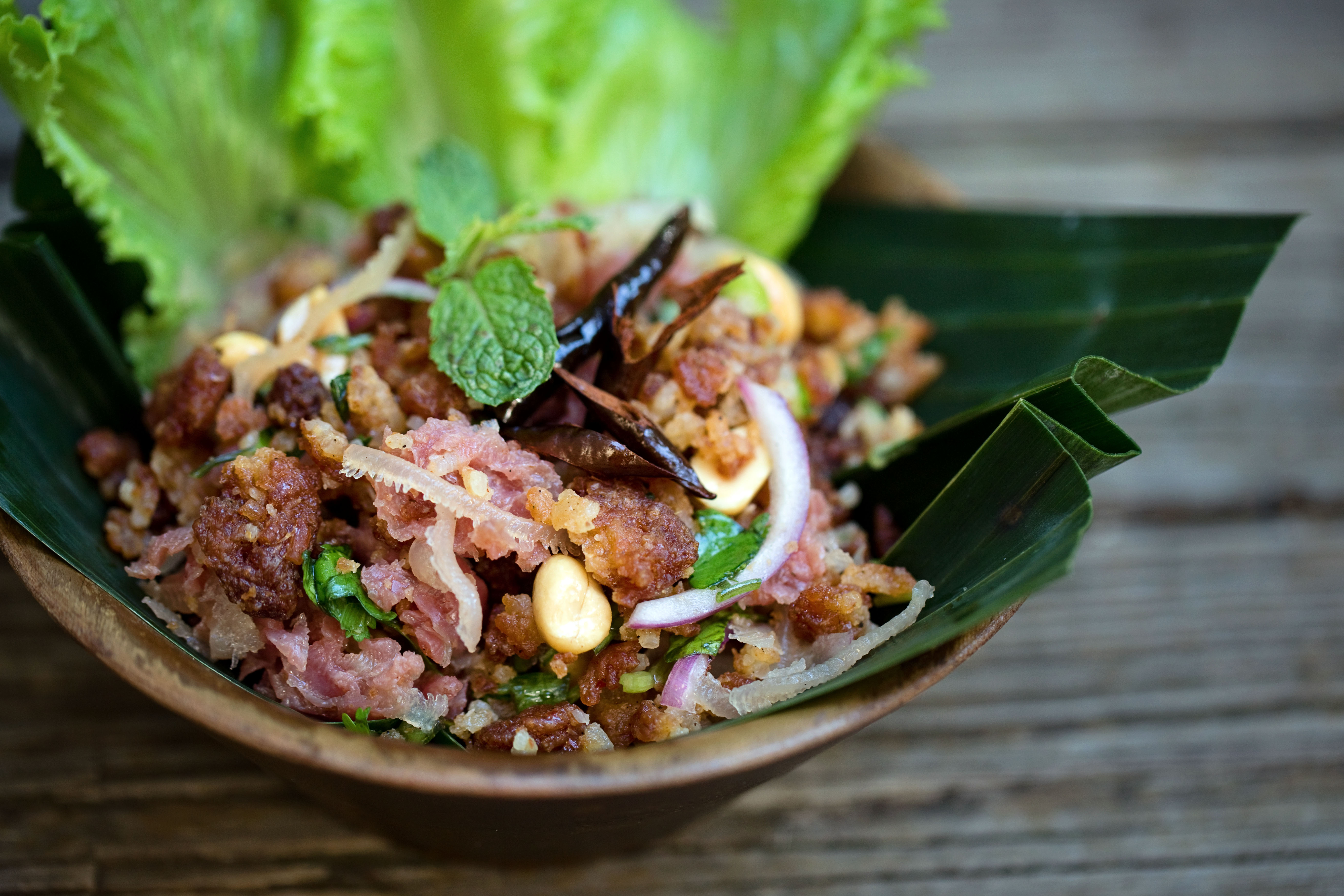 Nam khao or coconut rice salad with fermented pork or tofu at Snackboxe Bistro