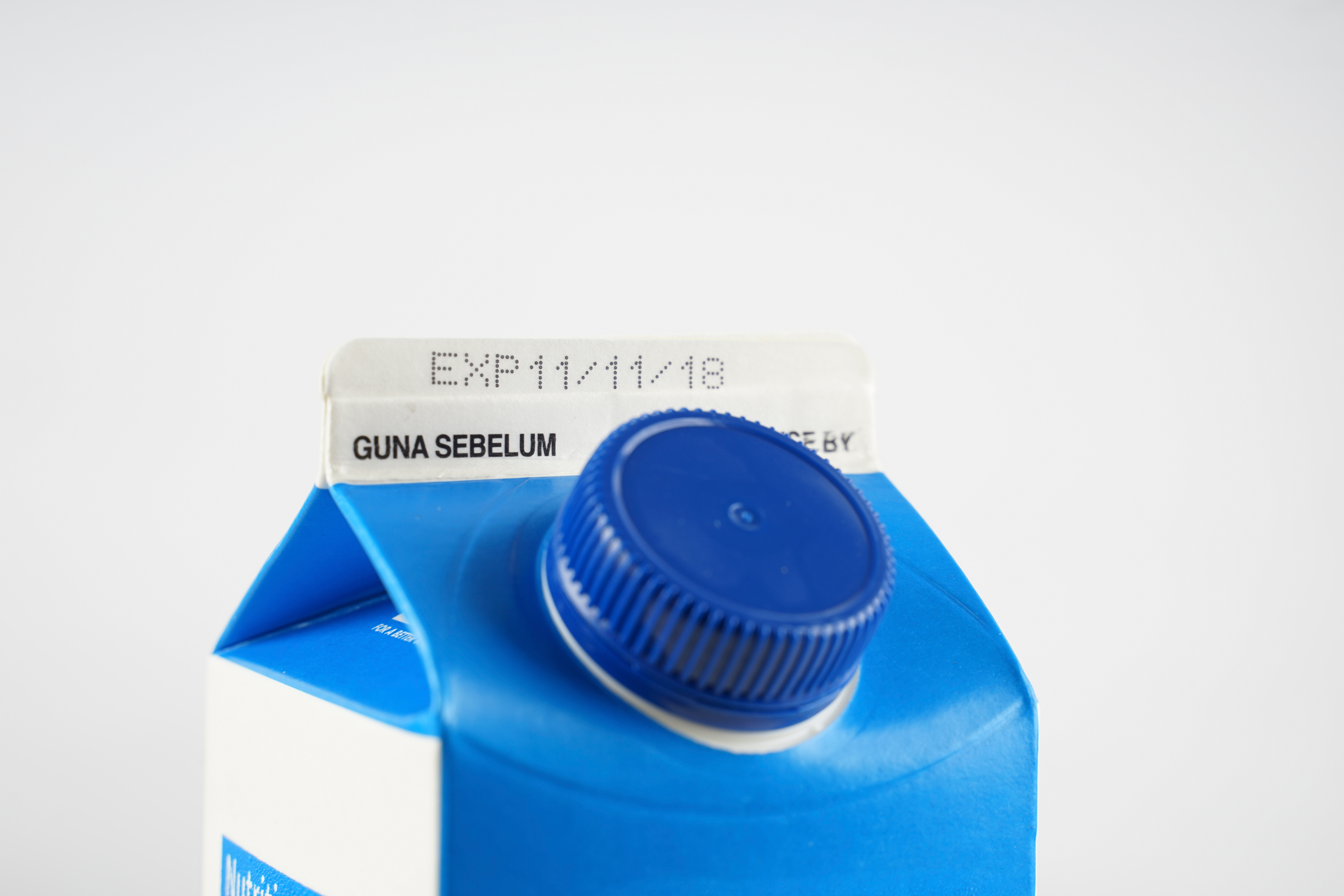 A milk carton with a sell-by date