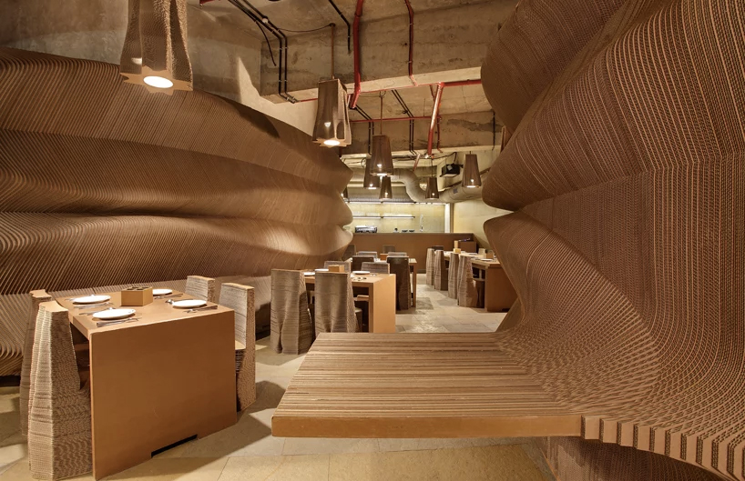 Inside a cafe made of cardboard