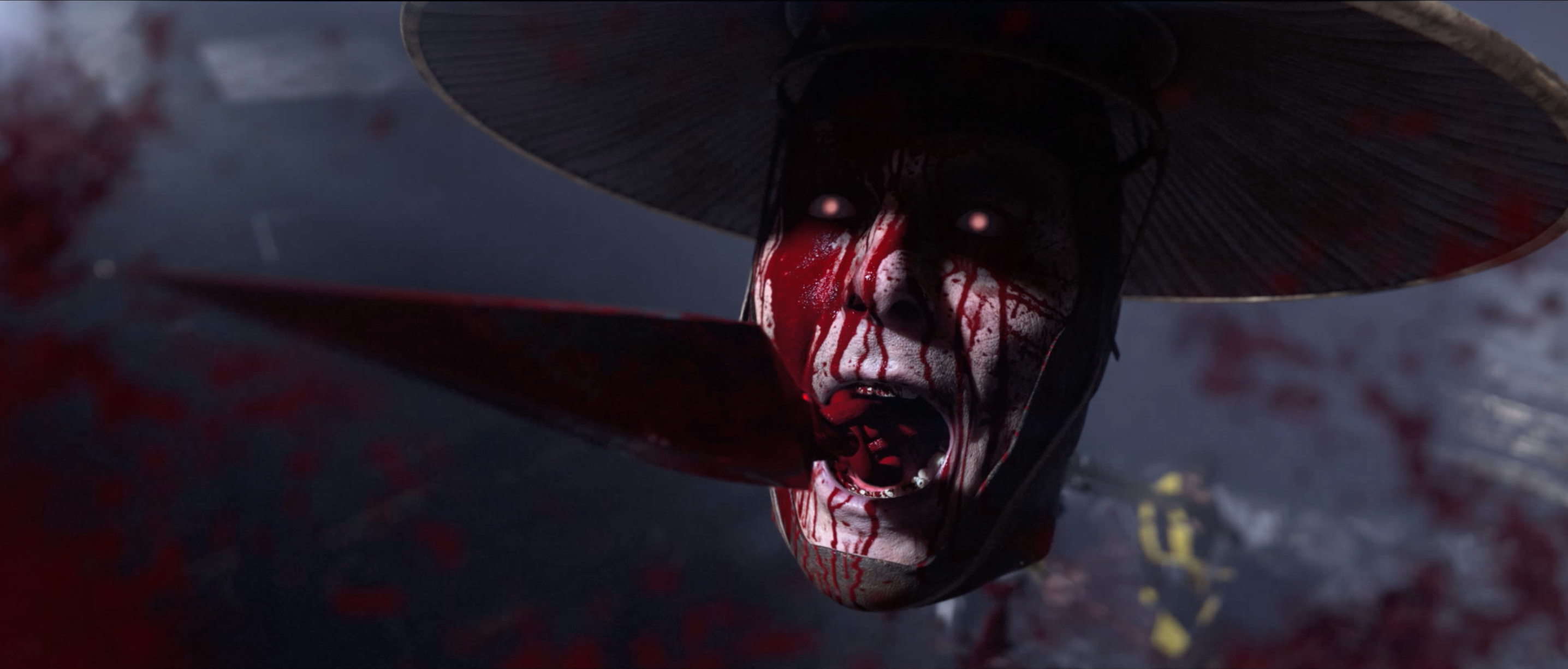 A close up of Raiden's head from Scorpion's fatality in the closing moments of the reveal trailer for MK11.