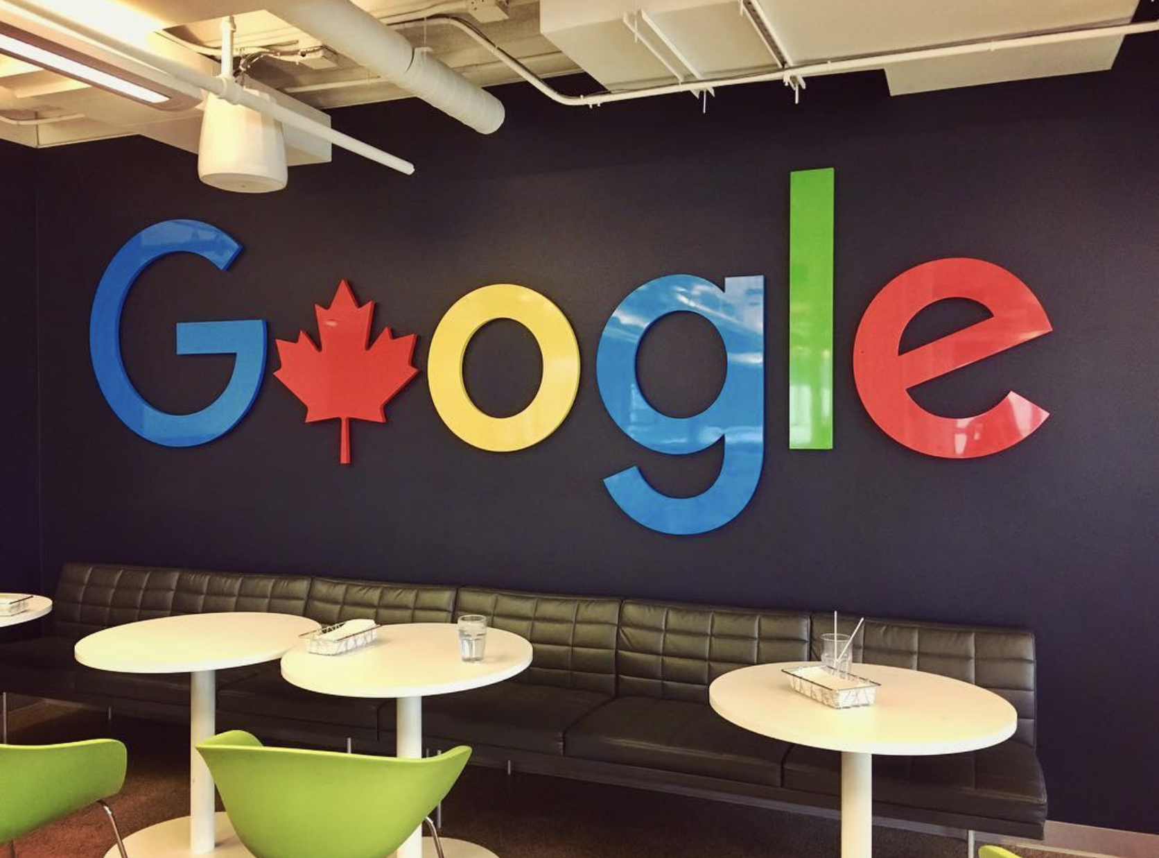 """The word """"Google"""" with the first """"o"""" replaced by a Canada maple leaf."""