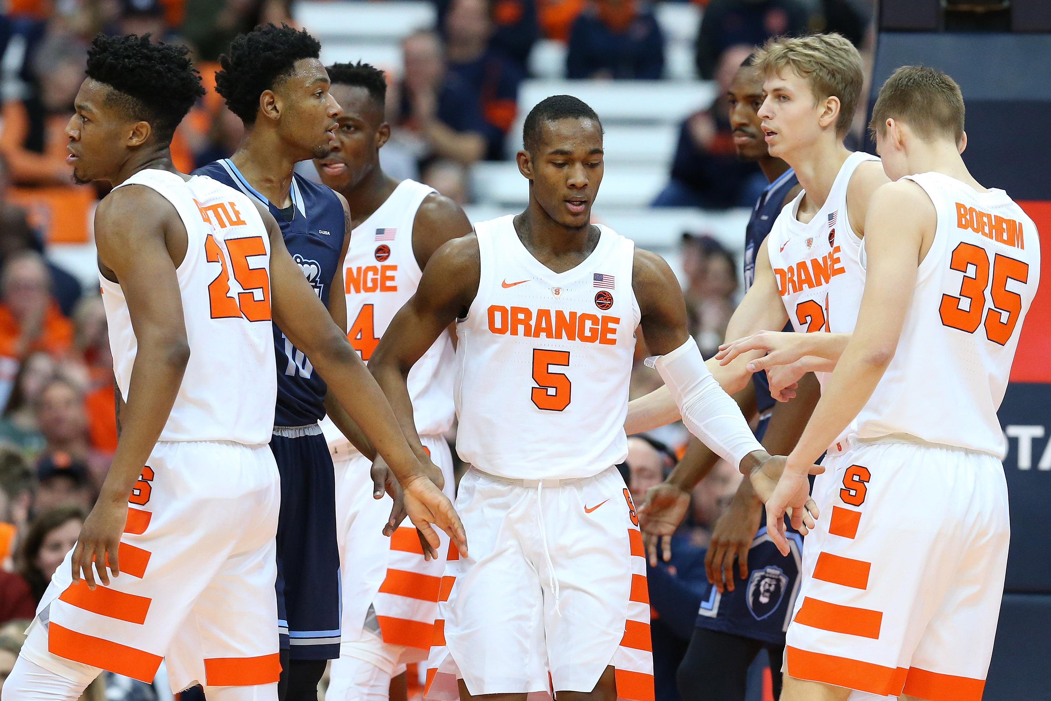 Syracuse Basketball: Jalen Carey celebrates with teammates.