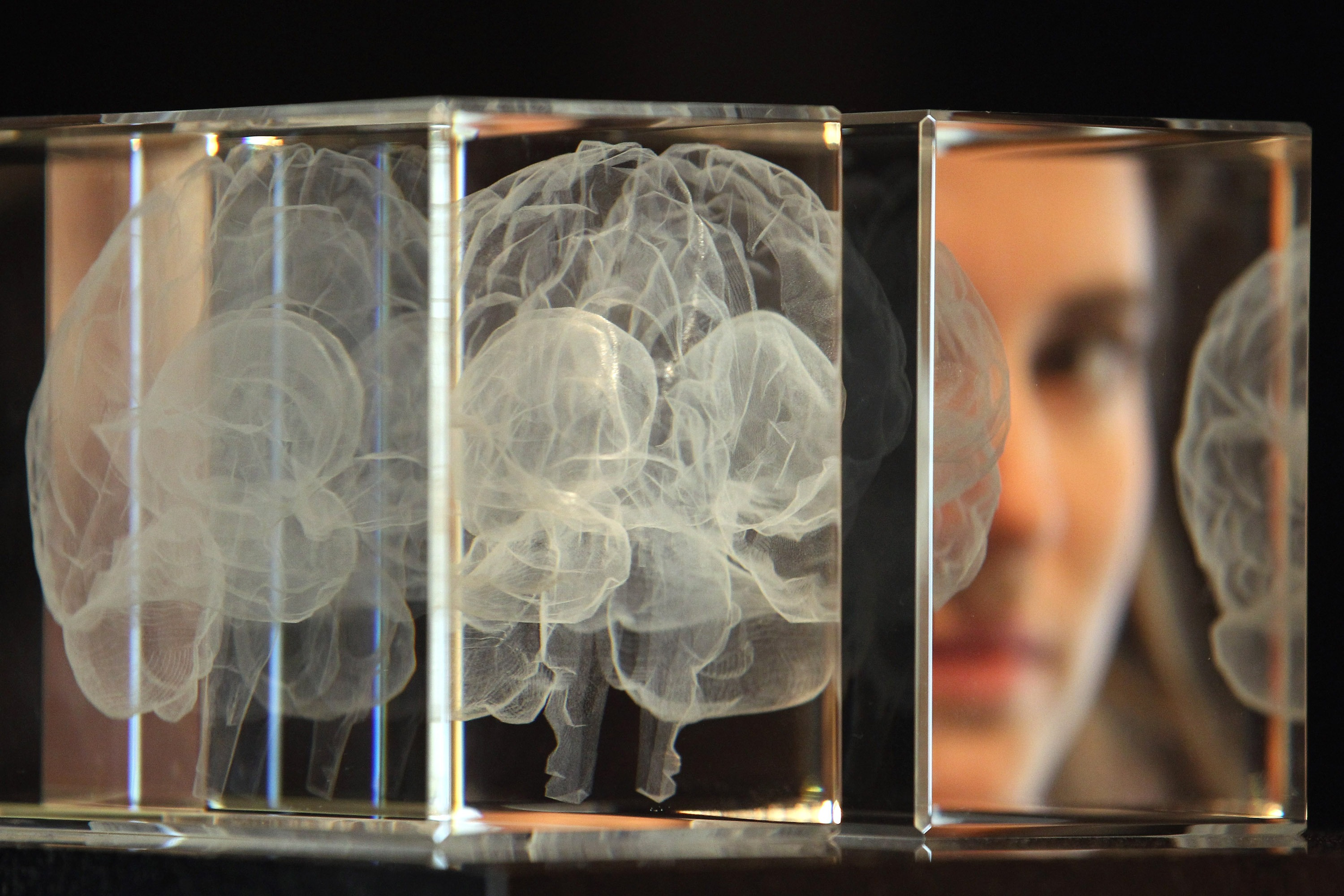 A visualization of a brain and a person's reflection in a mirror.