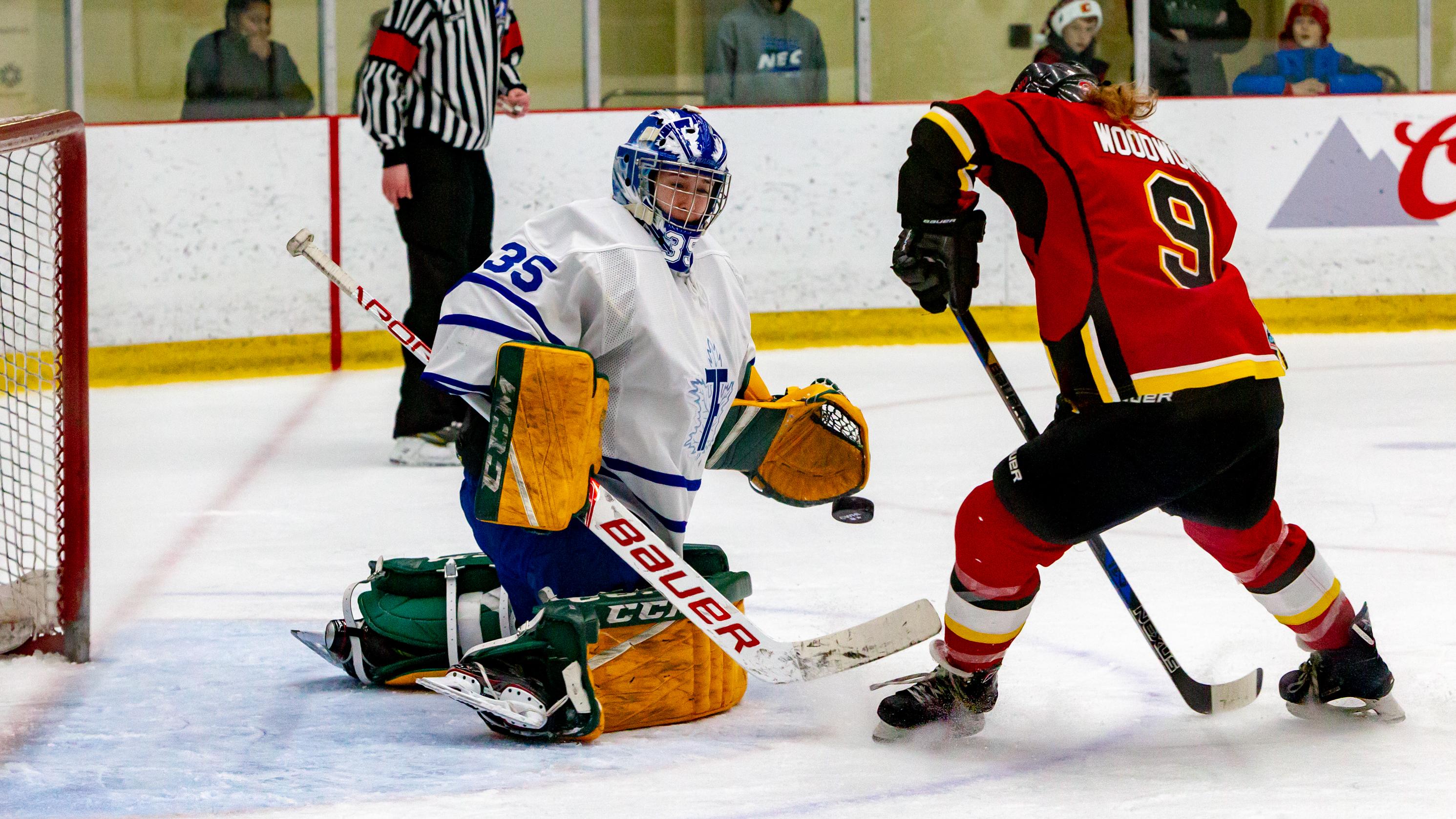 Shea Tiley of the Toronto Furies makes a save on Dakota Woodworth of the Calgary Inferno