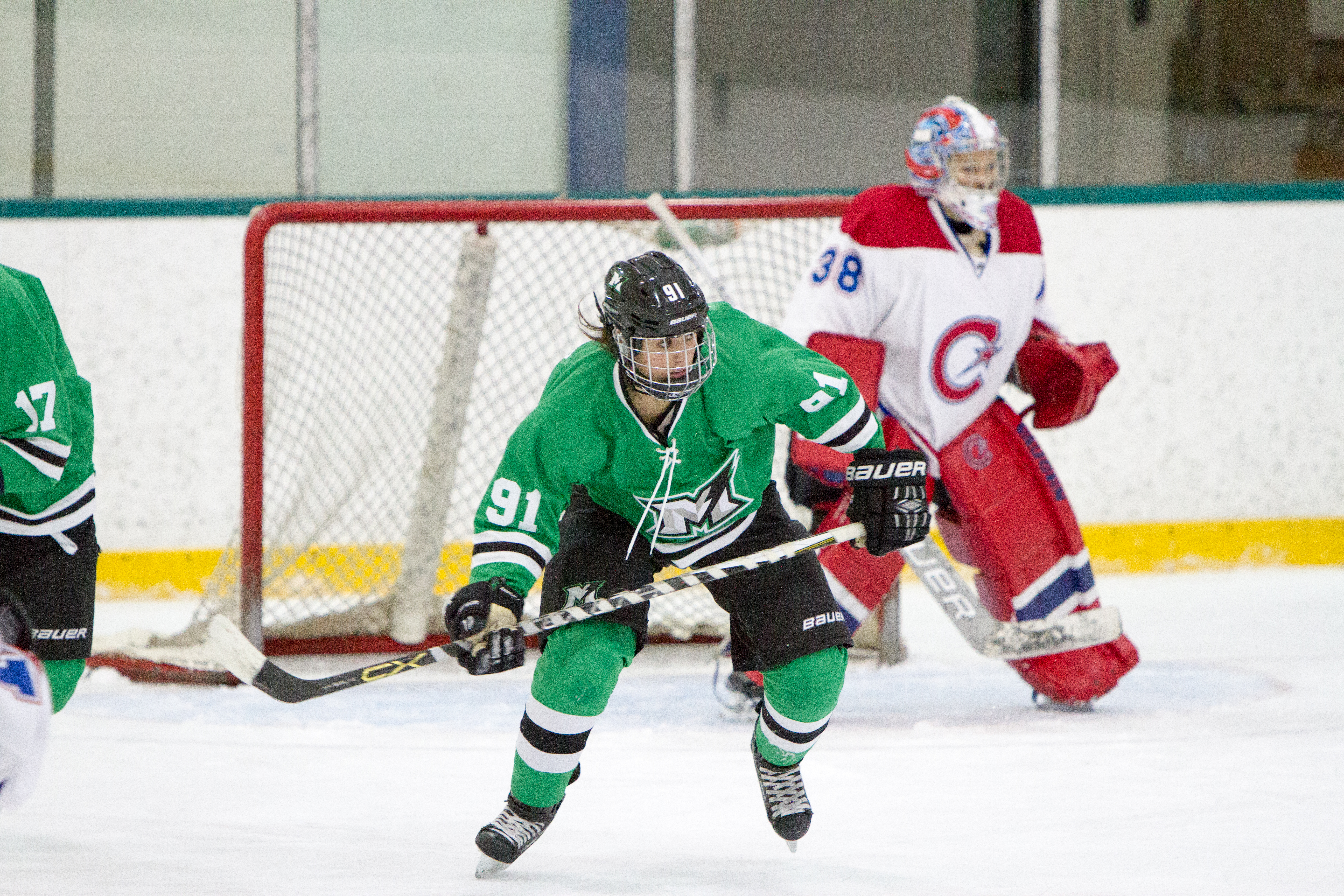 Jenna McParland of the Markham Thunder posed in front of the Montreal goal with goalie Emerance Maschmeyer in the background.
