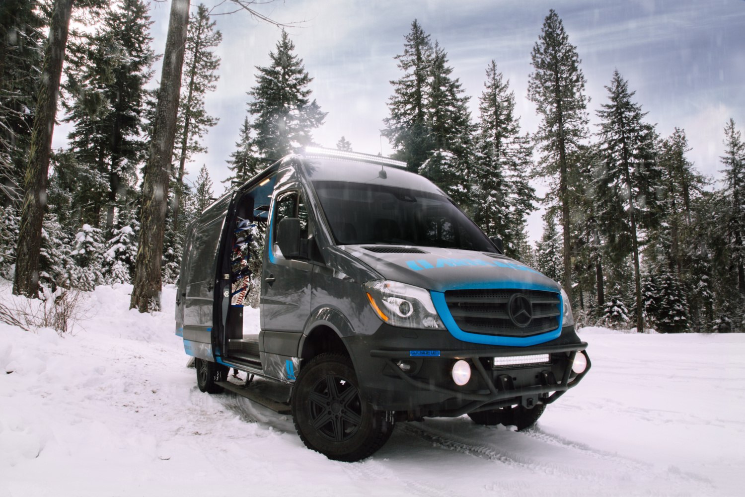 Sporty camper van fits a snowmobile and sleeps two