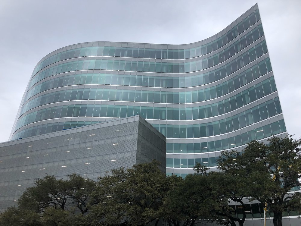 Large, curvy, glass office building
