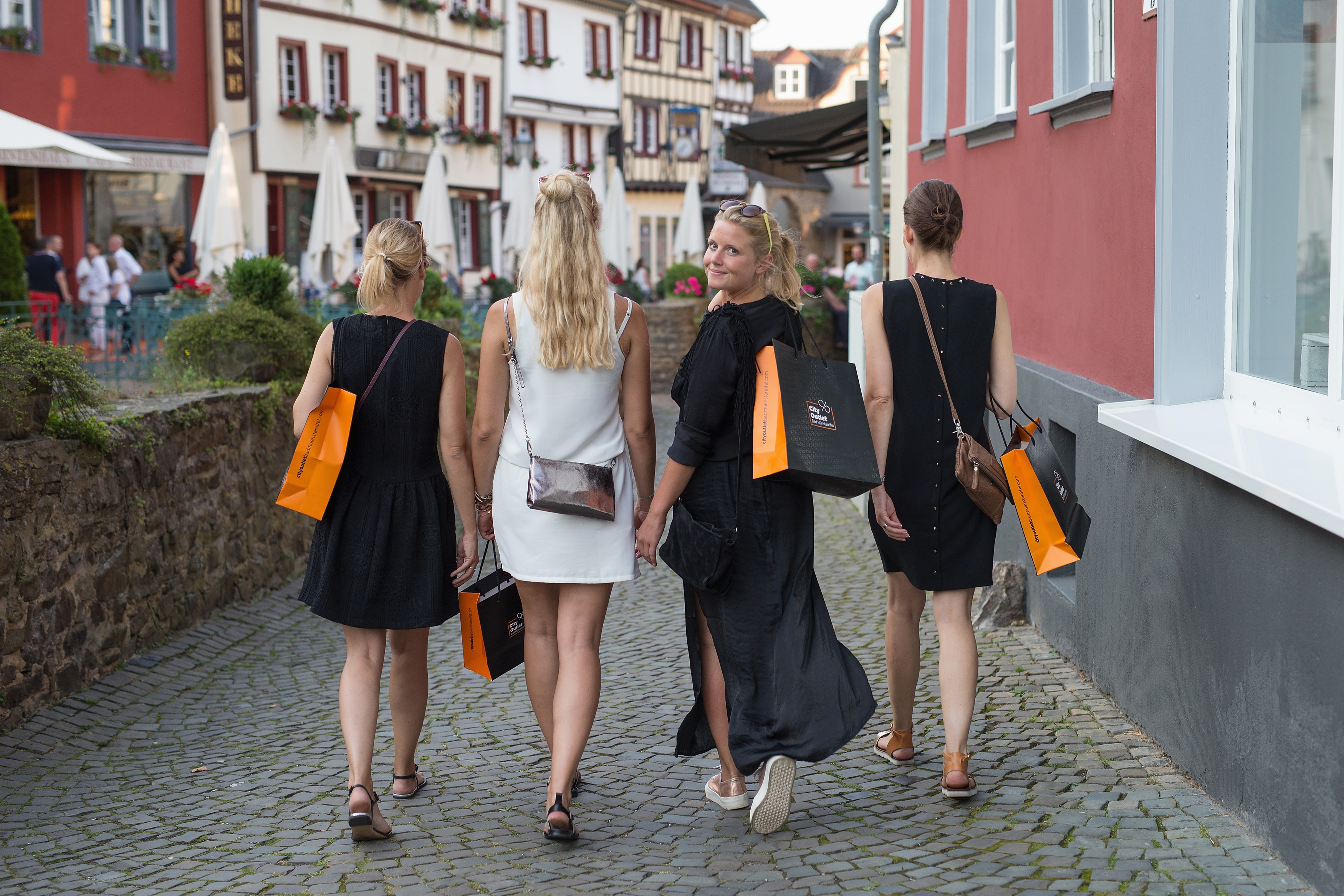 Women carrying shopping bags in Germany.