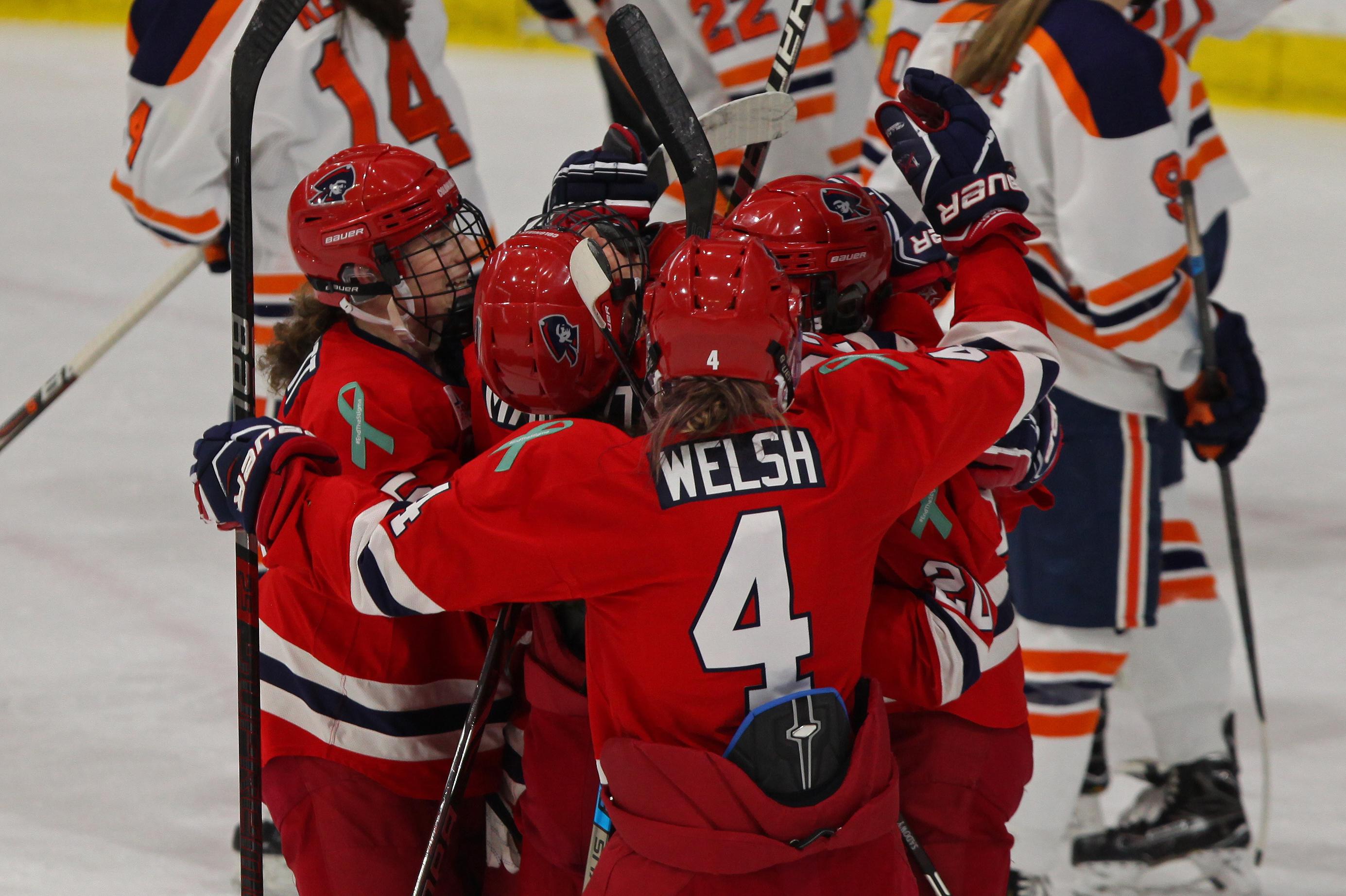 Kirsten Welsh and her Robert Morris teammates celebrate a goal against the Syracuse Orange.
