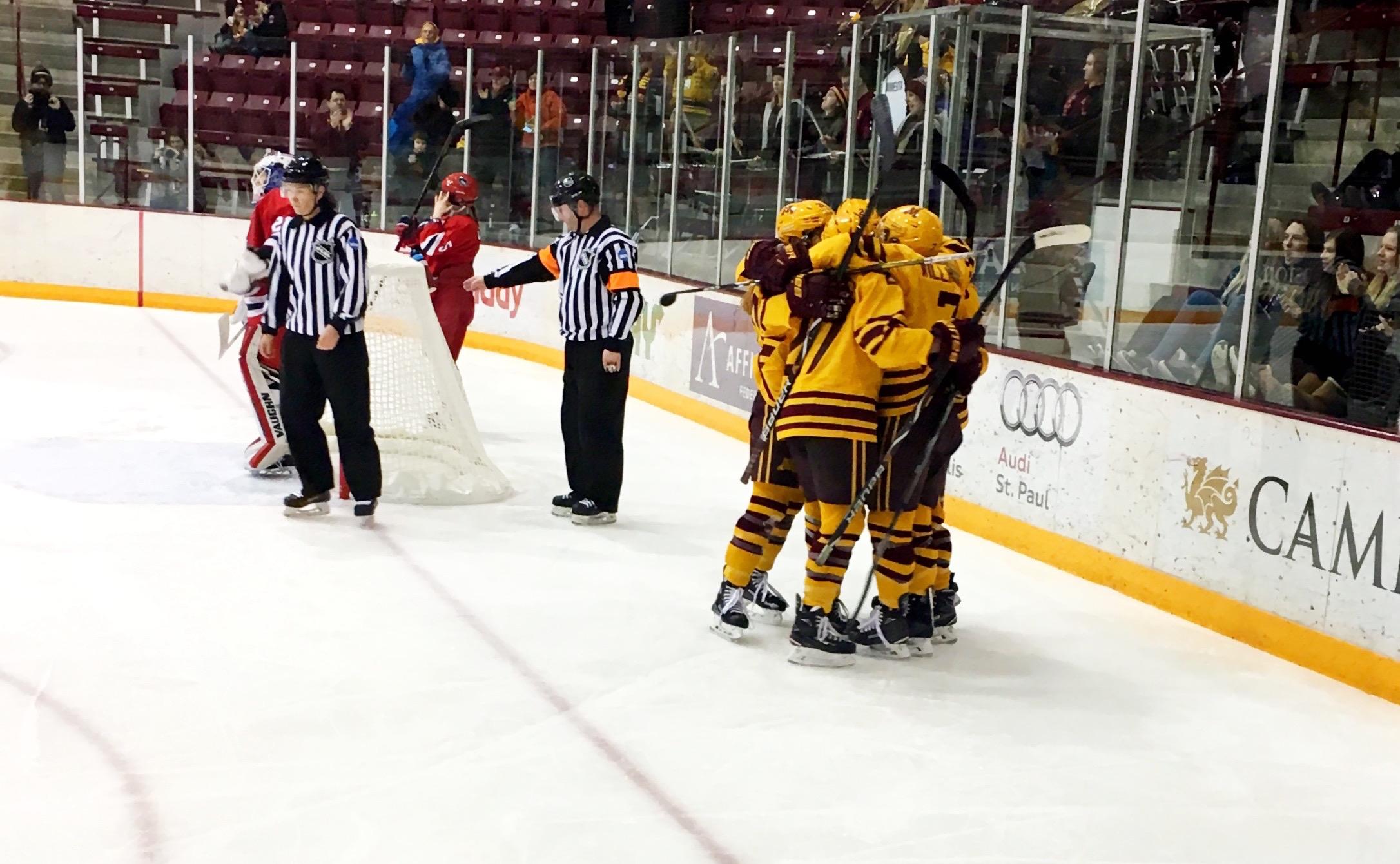 Gopher women hugging after a goal.