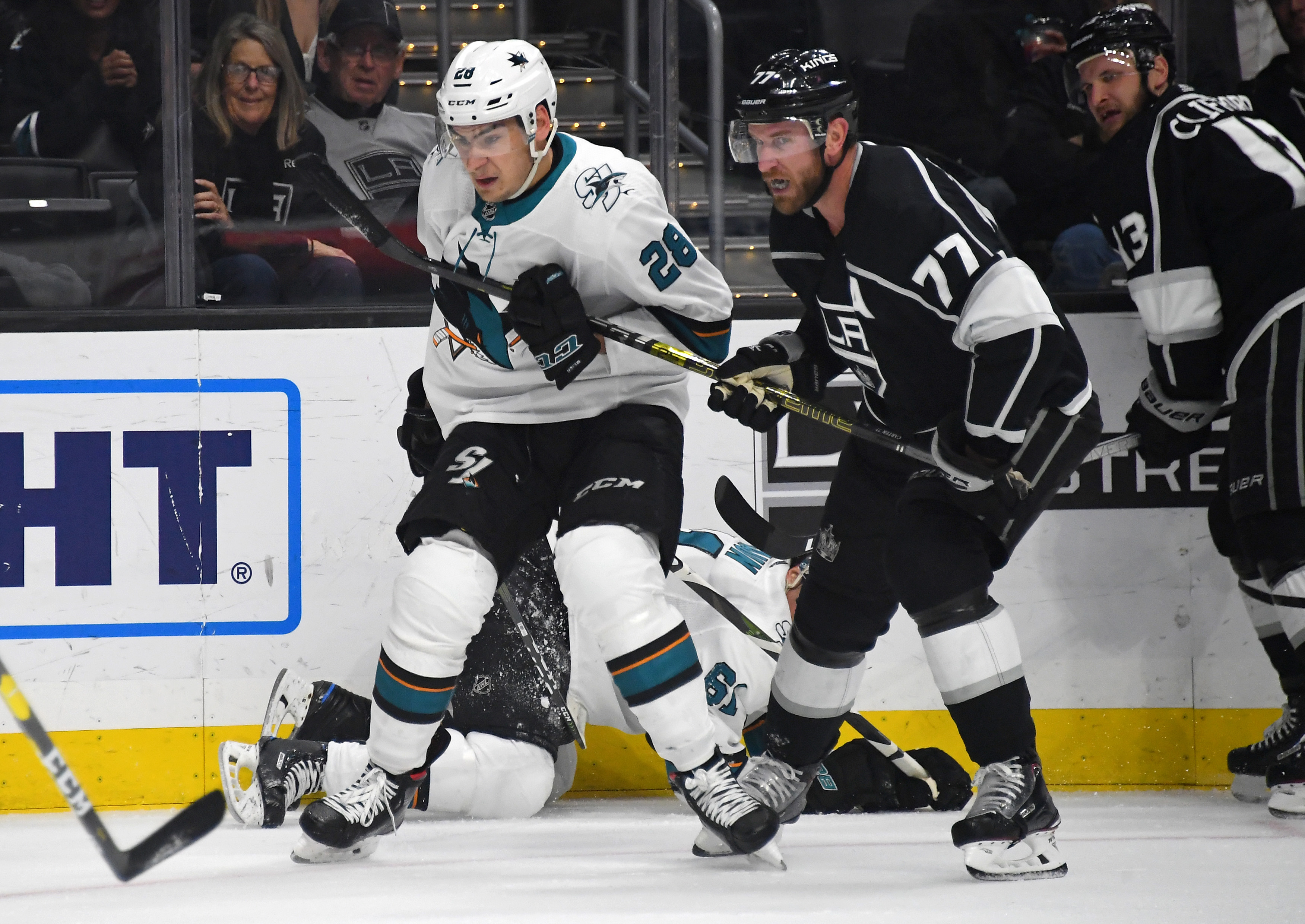 Mar 21, 2019; Los Angeles, CA, USA; Los Angeles Kings center Jeff Carter (77) and San Jose Sharks right wing Timo Meier (28) battle for position on the ice in the first period of the game at Staples Center. Mandatory Credit: Jayne Kamin-Oncea