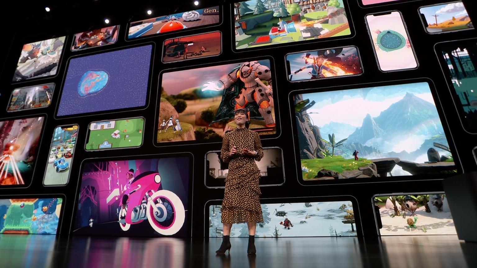 Apple's Ann Thai with Apple Arcade games behind her