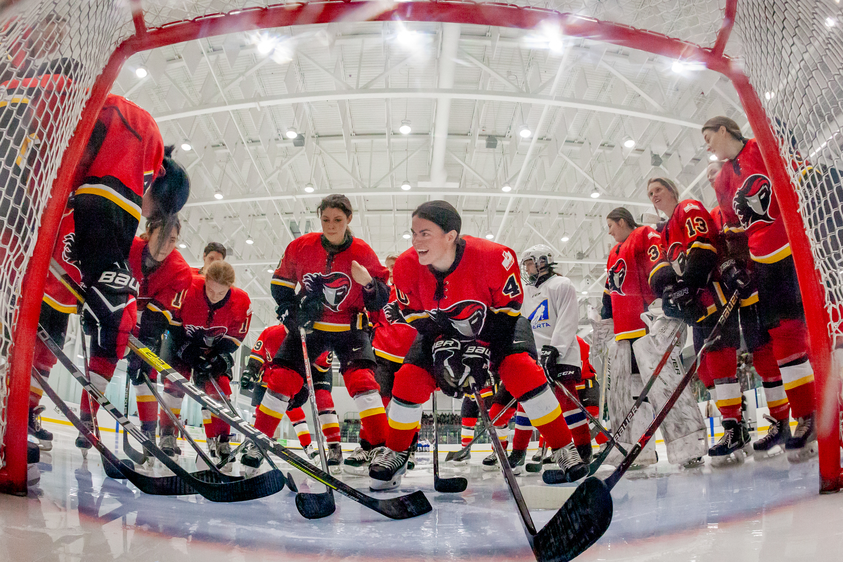 The Calgary Inferno gathered around the net prior to a game.