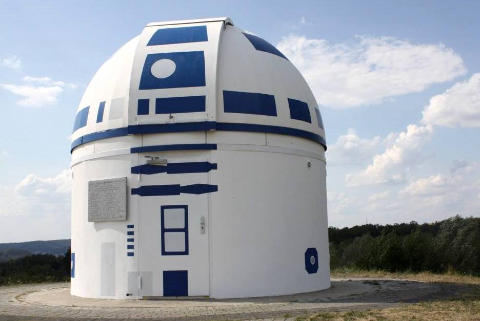 An observatory is painted white with blue patterns reminiscent of the android R2-D2 from Star Wars.
