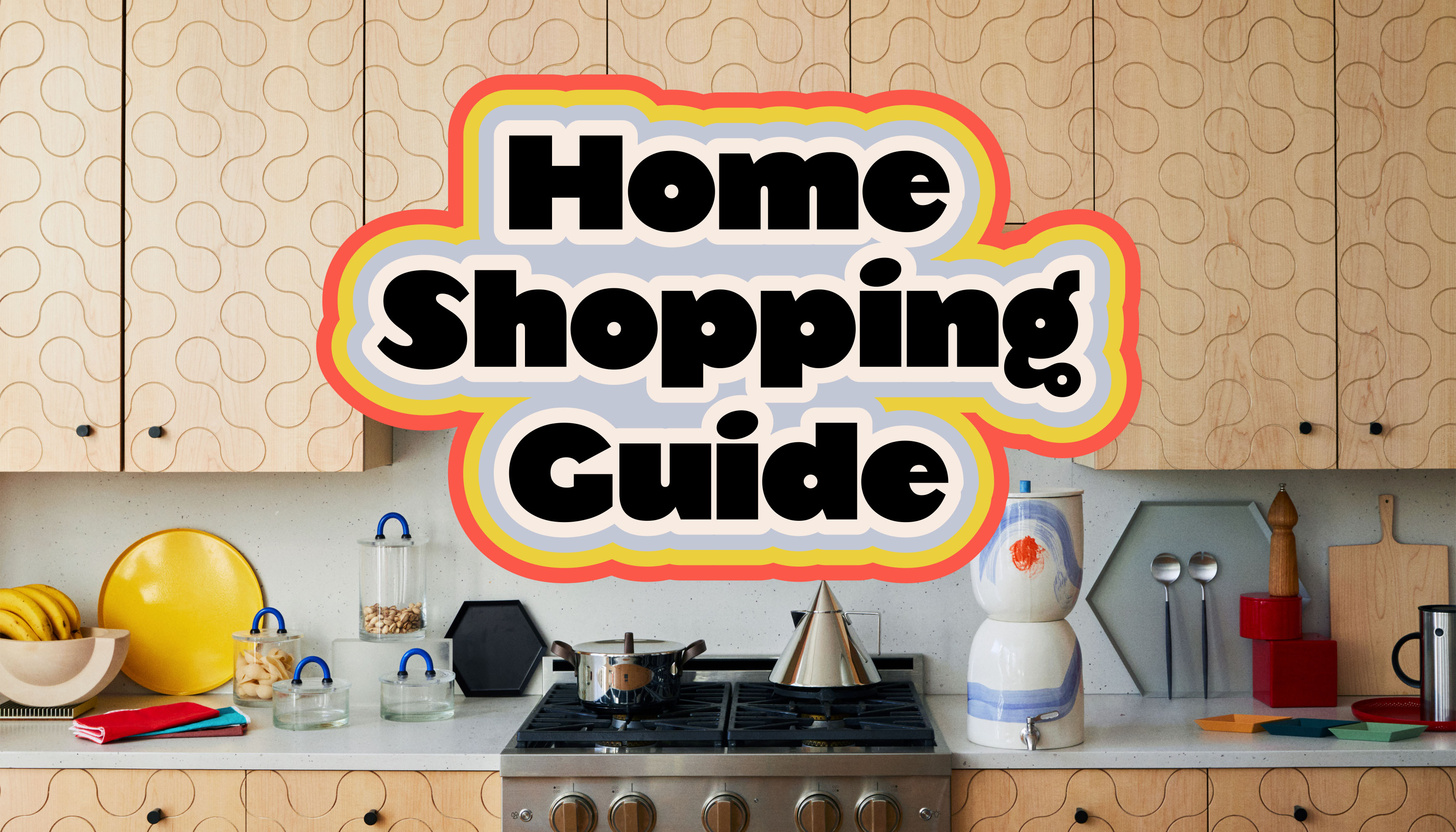 A kitchen counter with various kitchen appliances and tan cabinetry. Superimposed on the area are the words: Home Shopping Guide.