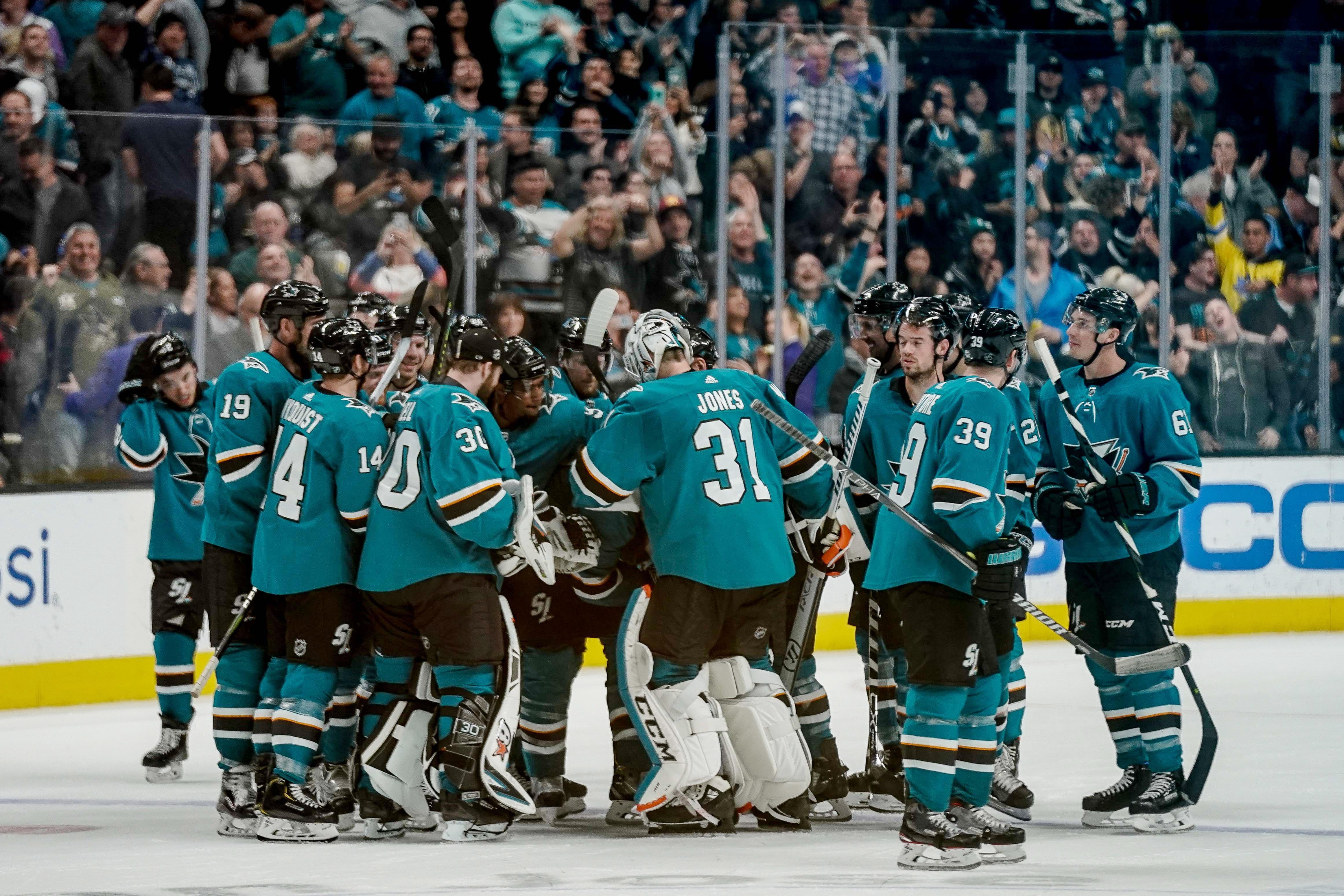 San Jose Sharks celebrate after defeating the Vegas Golden Knights during overtime at SAP Center at San Jose.