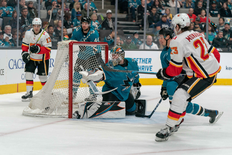Mar 31, 2019; San Jose, CA, USA; Calgary Flames center Austin Czarnik (27) scores a goal against San Jose Sharks goaltender Aaron Dell (30) during the first period at SAP Center at San Jose.